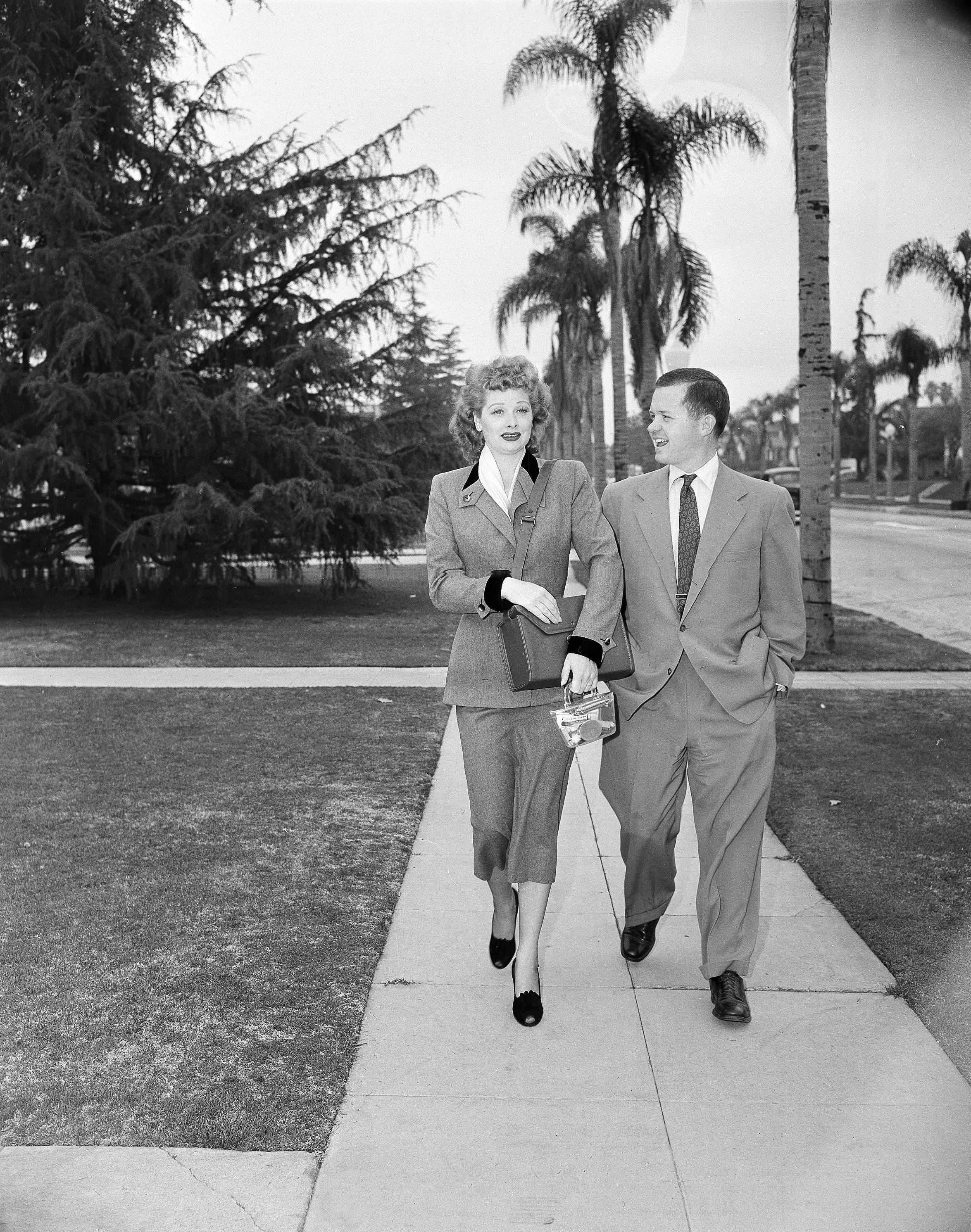 Associated Press reporter Bob Thomas accompanies Lucille Ball as she practices the part of a door-to-door saleswoman in 1950. Thomas, the longtime Associated Press reporter who kept the world informed on the comings and goings of Hollywood's biggest stars, died of age-related illnesses Friday, March 14, 2014.