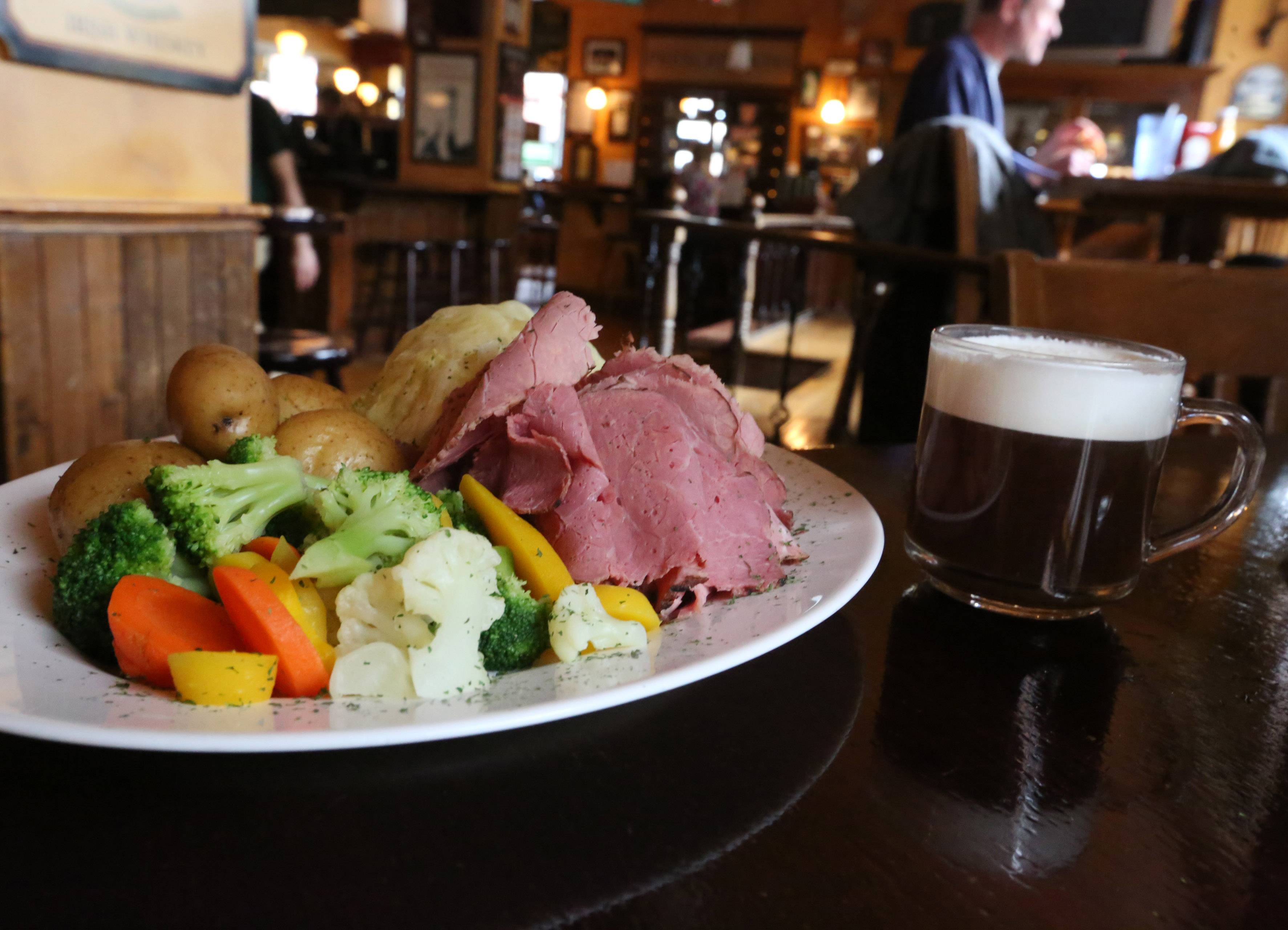 Corned beef, cabbage and potatoes with an Irish coffee are St. Patrick's Day specialties at Peggy Kinnane's Irish Restaurant and Pub in Arlington Heights.