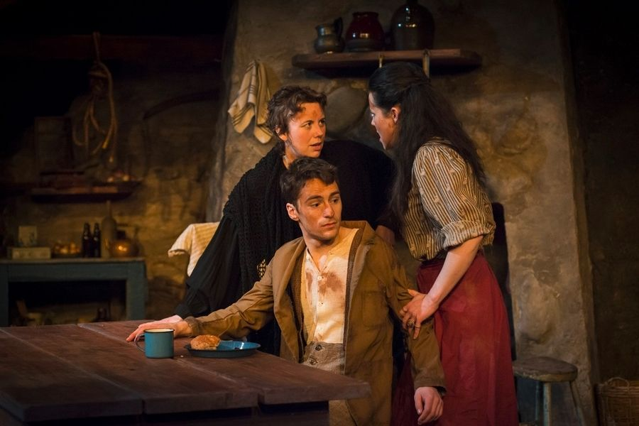 "Widow Quinn (Sarah Hayes) and barmaid Pegeen Mike (Jen Short) argue over the affections of alleged murderer Christy Mahon (Sam Hubbard) in Raven Theatre's production of John M. Synge's once-scandalous 1907 Irish play ""The Playboy of the Western World."""
