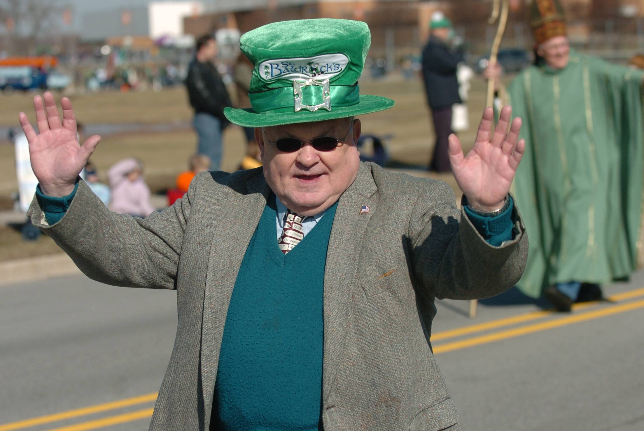 Naperville Mayor George Pradel waves to parade goers during a past West Suburban Irish St. Patrick's Day Parade in Naperville.