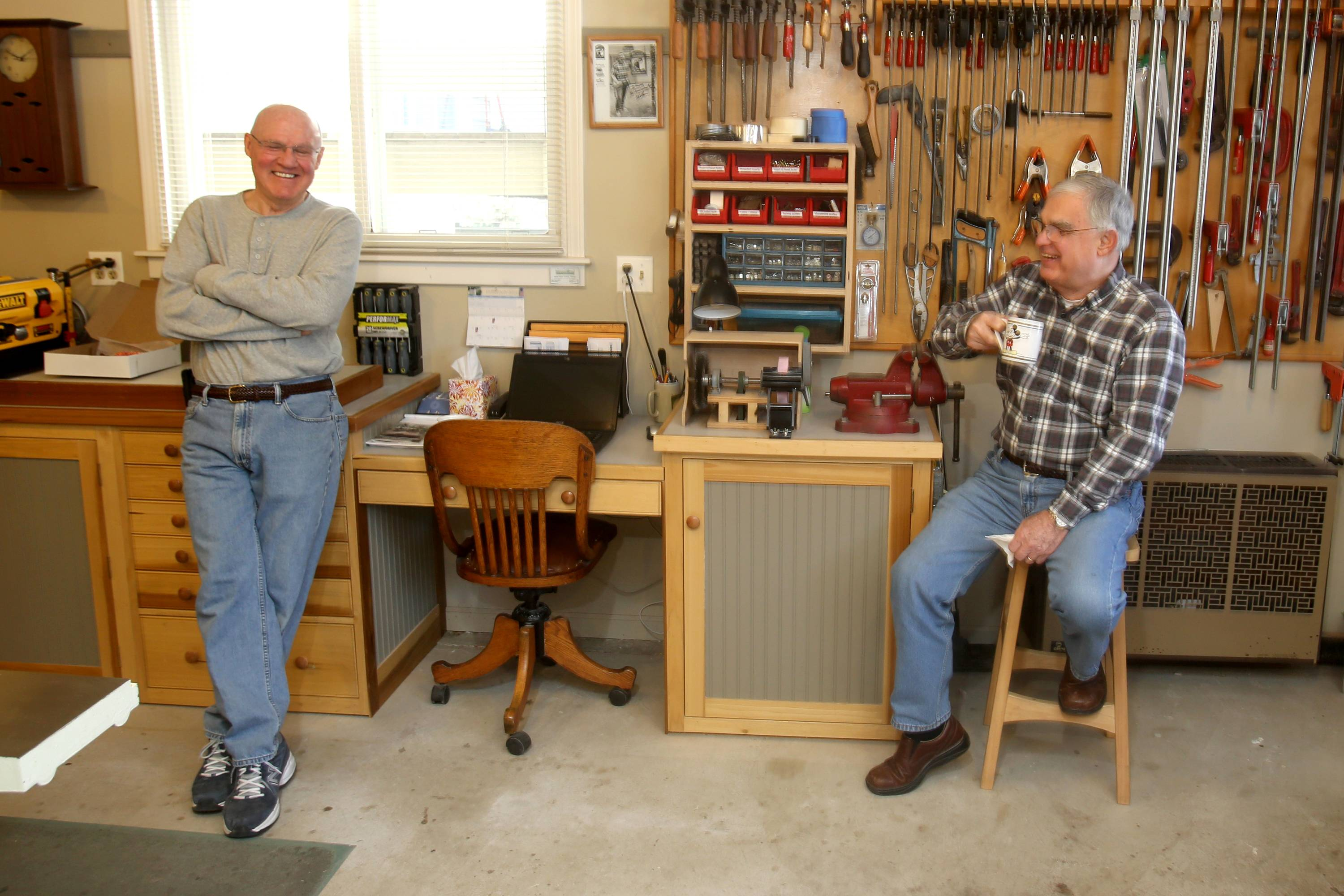 Wayne Maier of Glen Ellyn enjoys his woodworking shop where he relaxes with friends like Len Swanson, right.