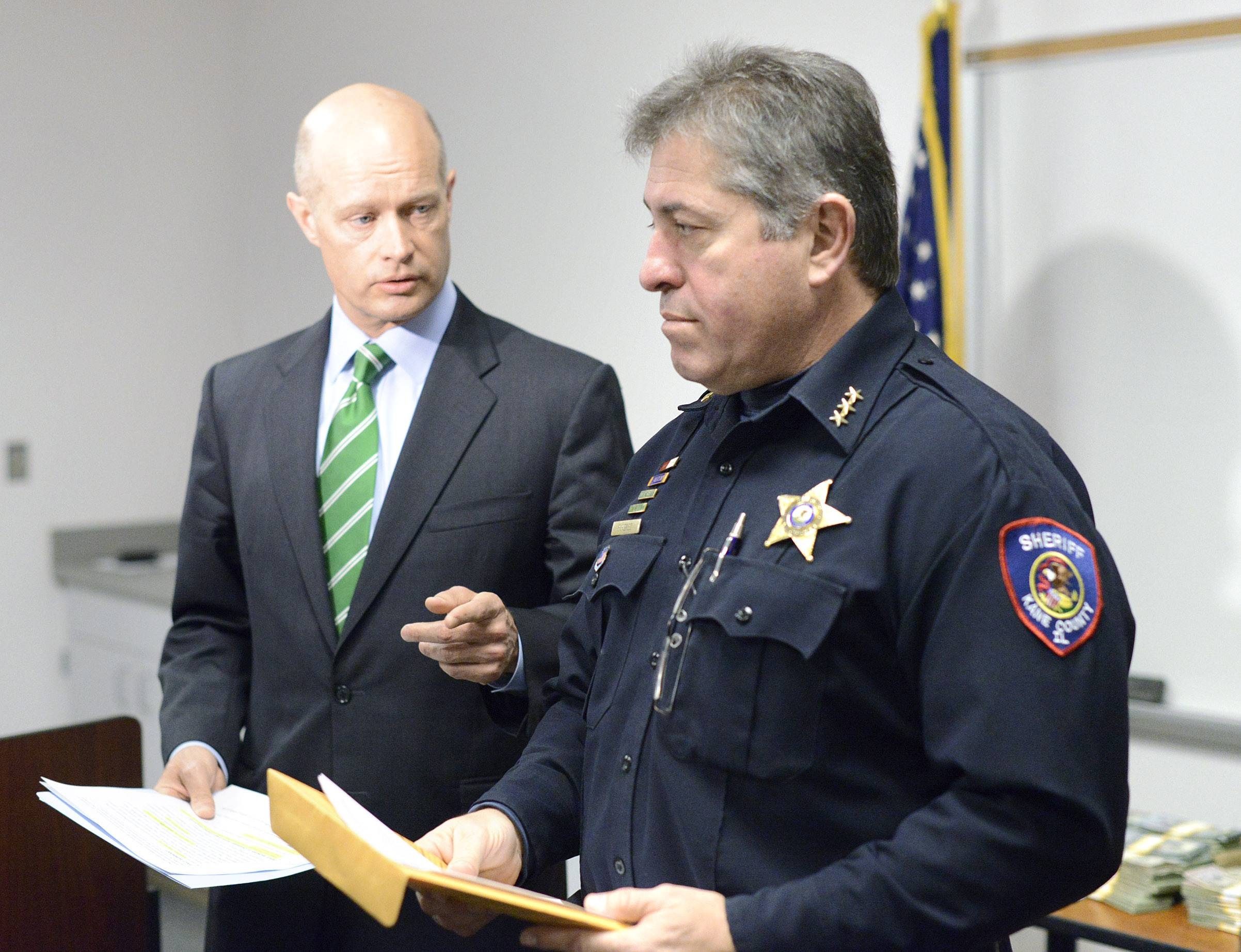 Kane County State's Attorney Joe McMahon, left, and Kane County Sheriff Pat Perez announced the seizure of 17 kilograms of cocaine with an estimated street value of more than $1.6 million, and $259,569 in cash at a news conference Friday at the sheriff's office in St. Charles.