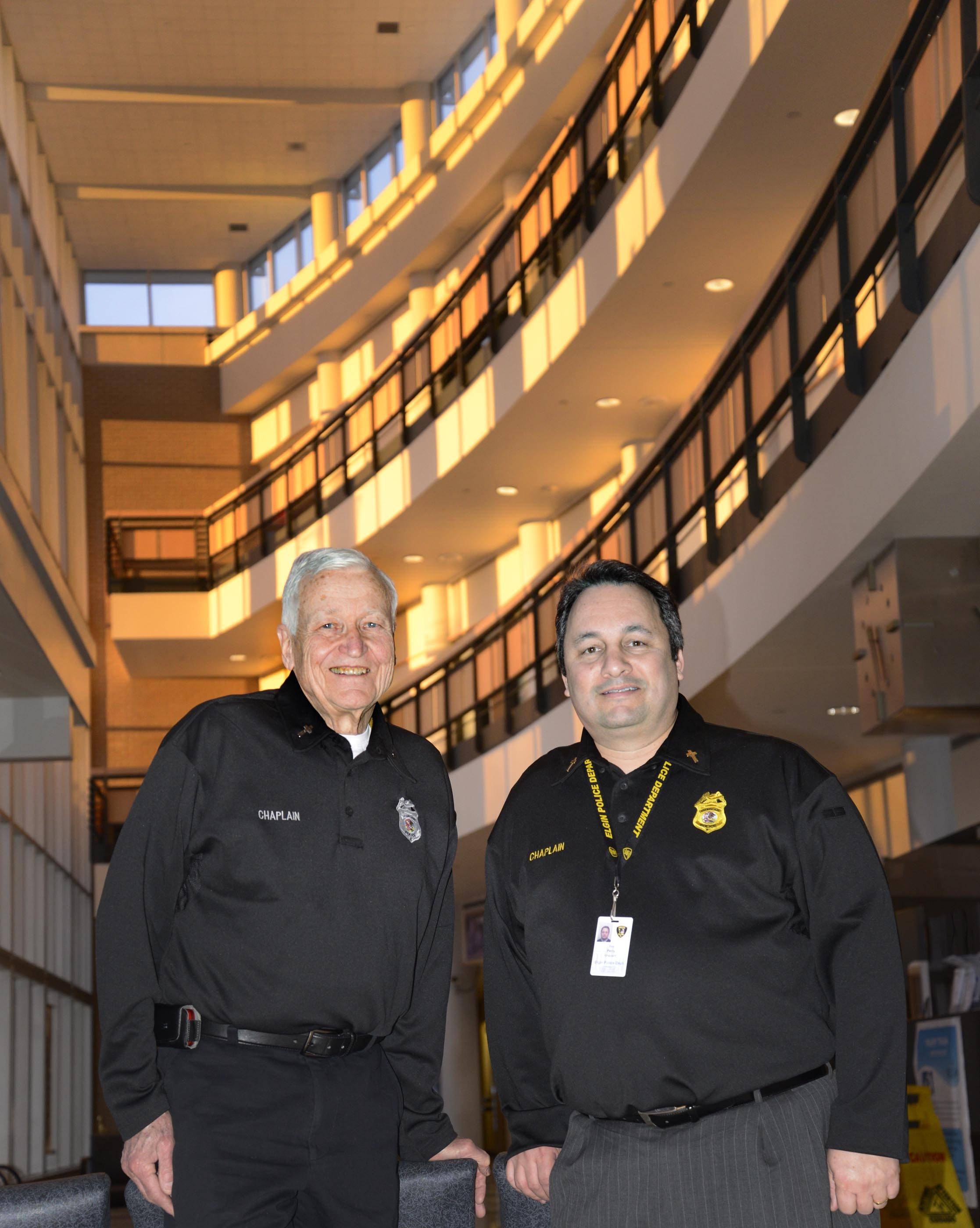 Carl Ball, left, and Tim Perry are chaplains with the Elgin Police Department. Perry is working on expanding the scope of the Northwest Corridor Chaplaincy Service to help place chaplains at police and fire departments across the suburbs.