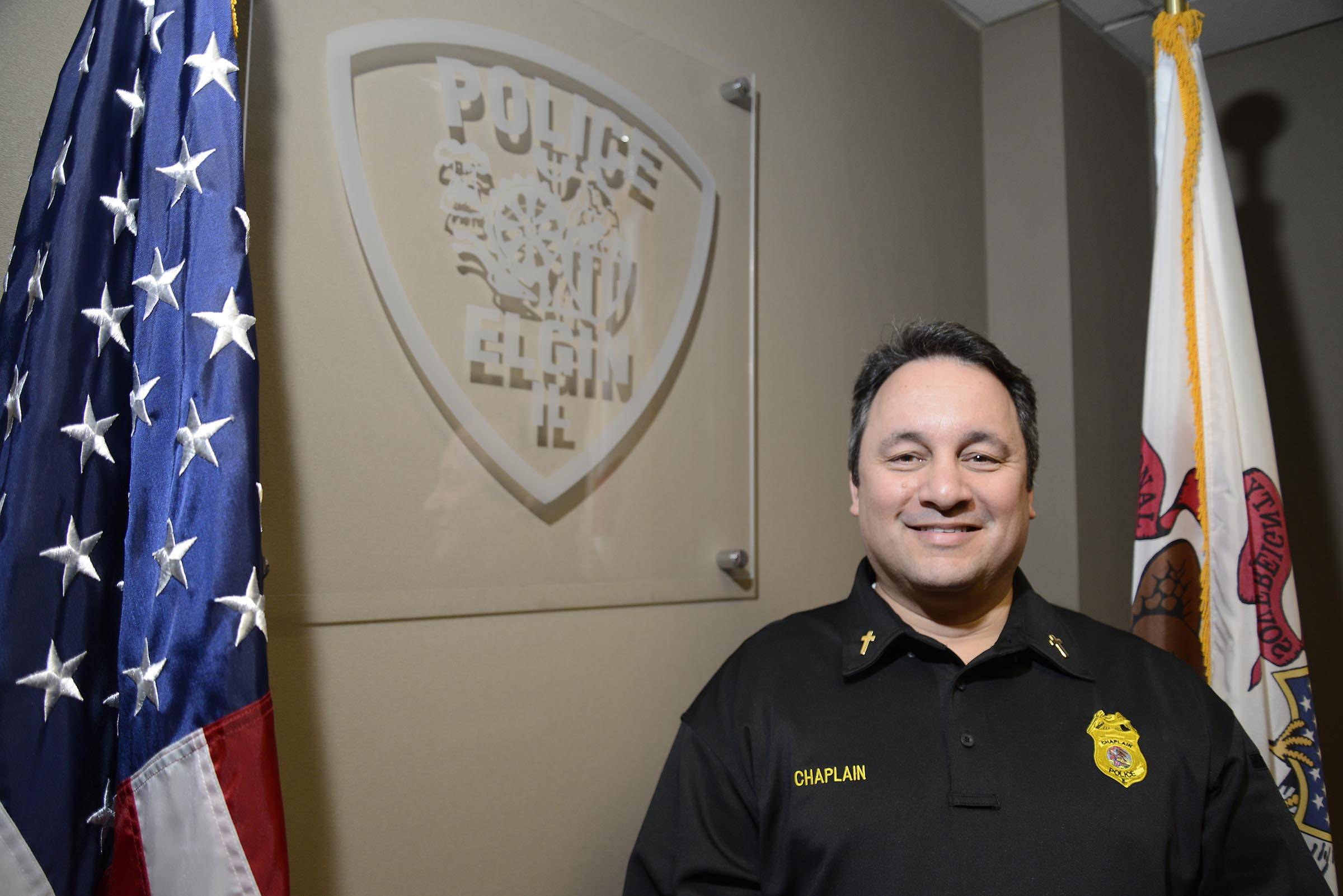 Senior Chaplain Tim Perry of the Elgin Police Department has spearheaded the expansion of the chaplaincy program by adding several members since last summer. He's a seminary school graduate who works as human resources manager in Schaumburg.