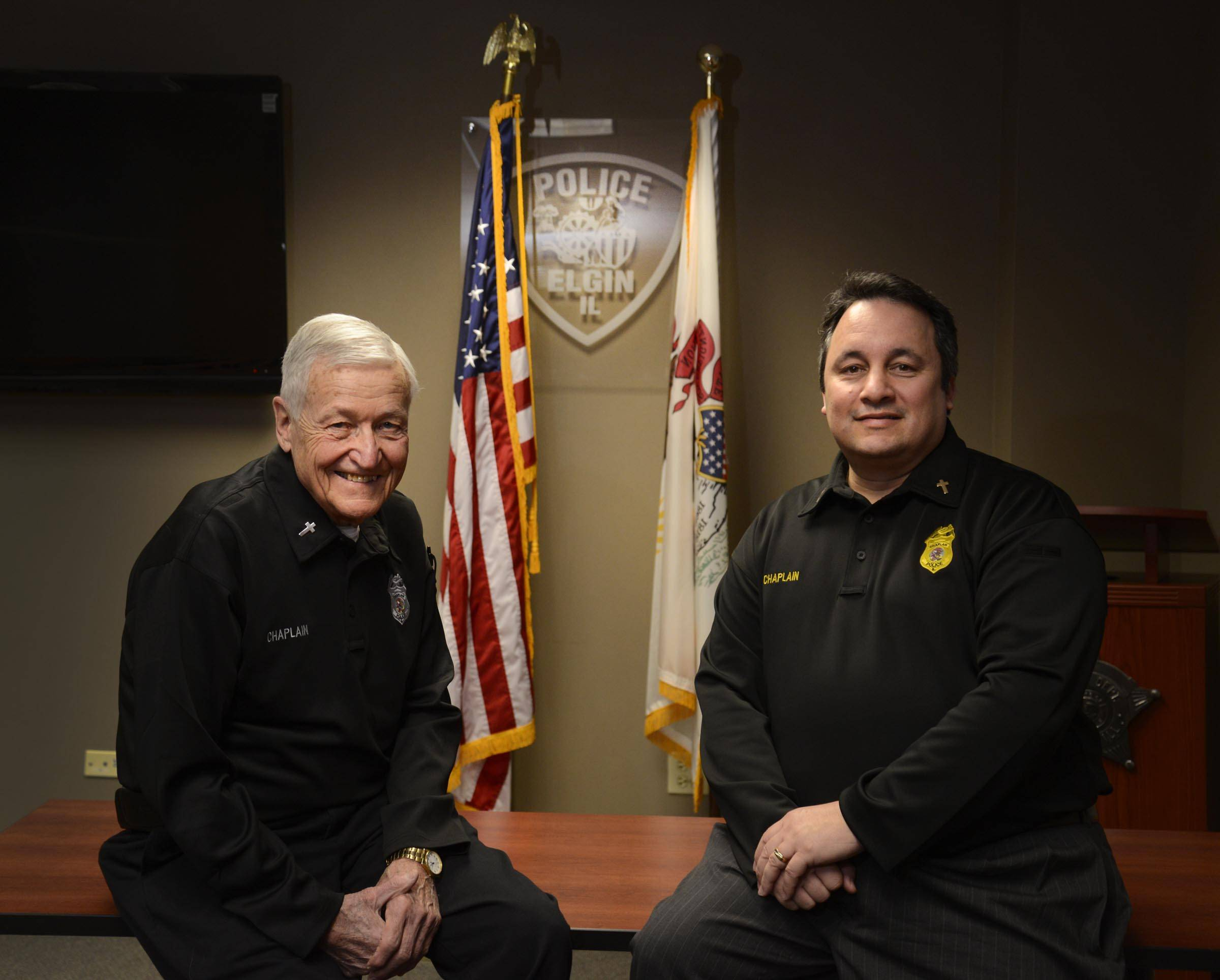 Carl Ball, left, and Tim Perry are chaplains with the Elgin Police Department. Ball has 47 years of experience working on law enforcement, and Perry is working on expanding the scope of the Northwest Corridor Chaplaincy Service to help place chaplains at police and fire departments across the suburbs.