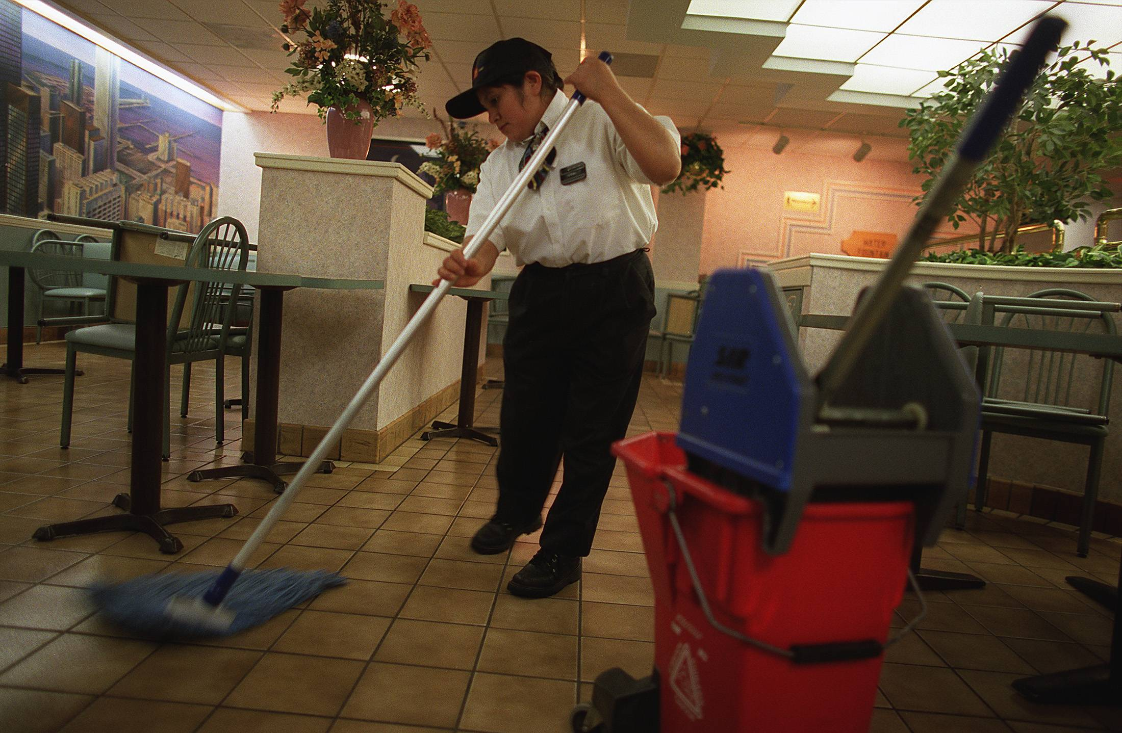 An empty lobby gives McDonald's employee Teresa Cervamtets, of Chicago, plenty of time to mop at the Des Plaines Oasis