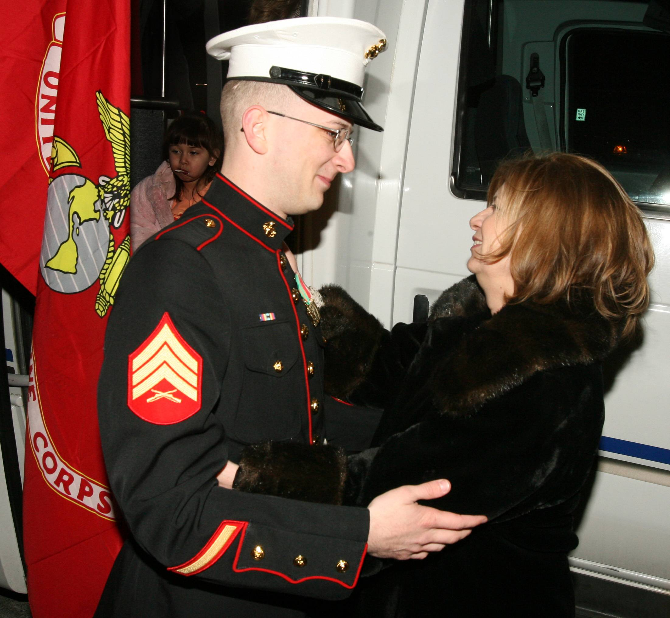 Marine Sgt Lee Bode, 27, is greeted at the Des Plaines Oasis and escorted to his Elk Grove home by Patriot Guard members and police. Above, he hugs his mother Diane Madax.
