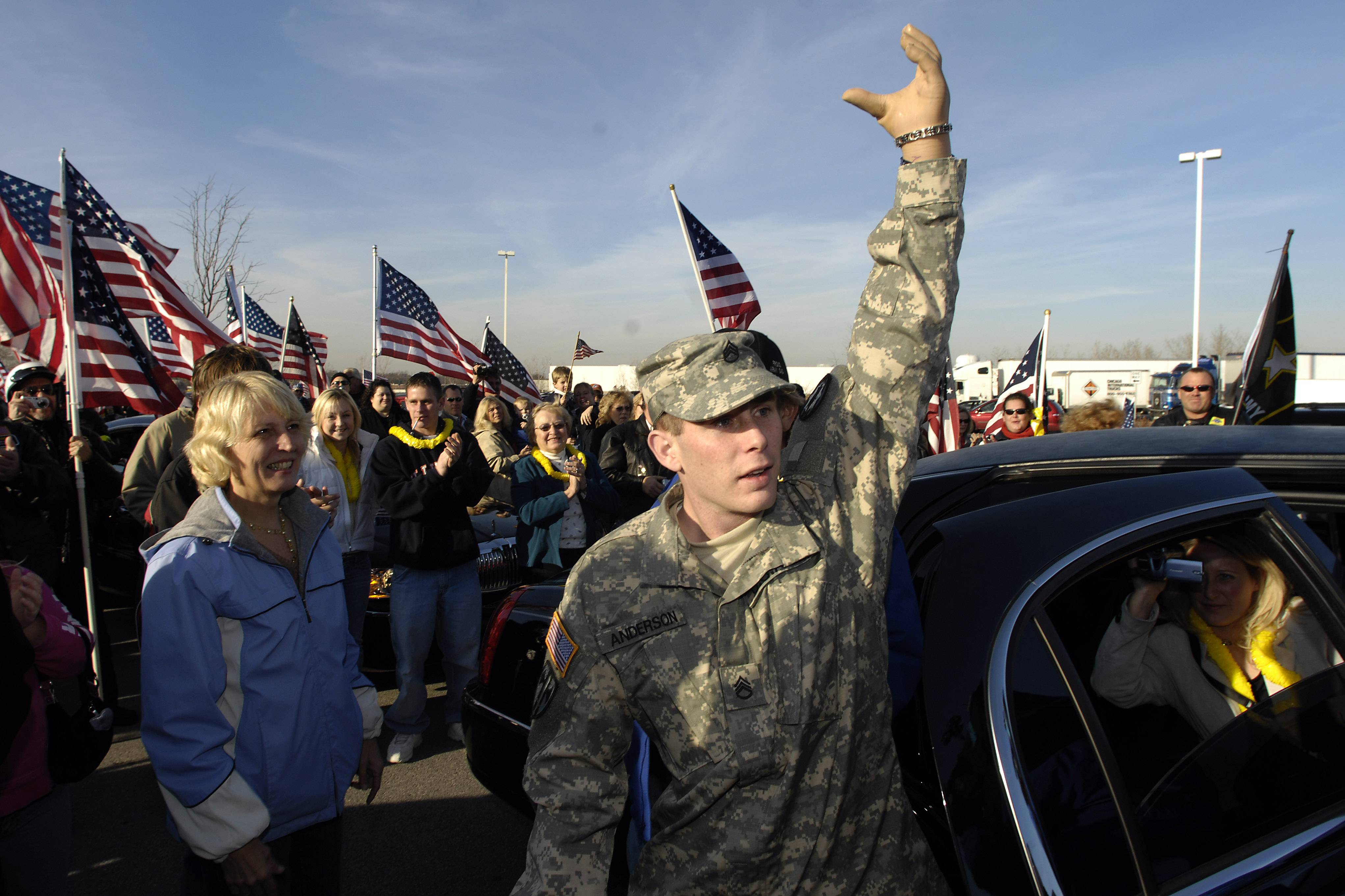 Rolling Meadows resident Bryan Anderson returns home to a heroes welcome as his parents and friends meet up with the Patriot Guard Riders at the Des Plaines Oasis. Here Bryan greets the crowd as he emerges from the limo.
