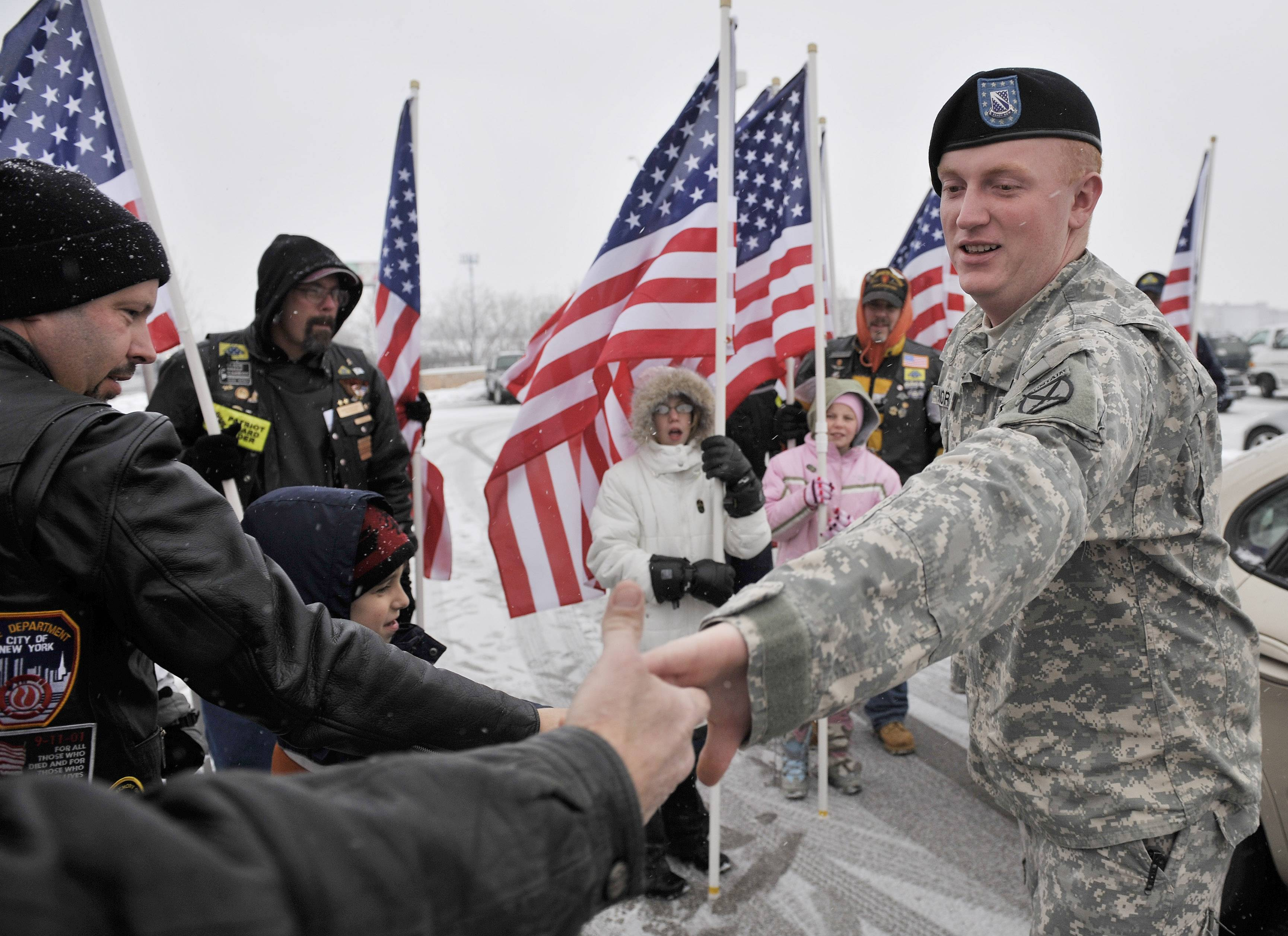 John Moran of North Barrington is greeted by the Patriot Guard Riders at the Des Plaines Oasis upon his return from active duty in Iraq.