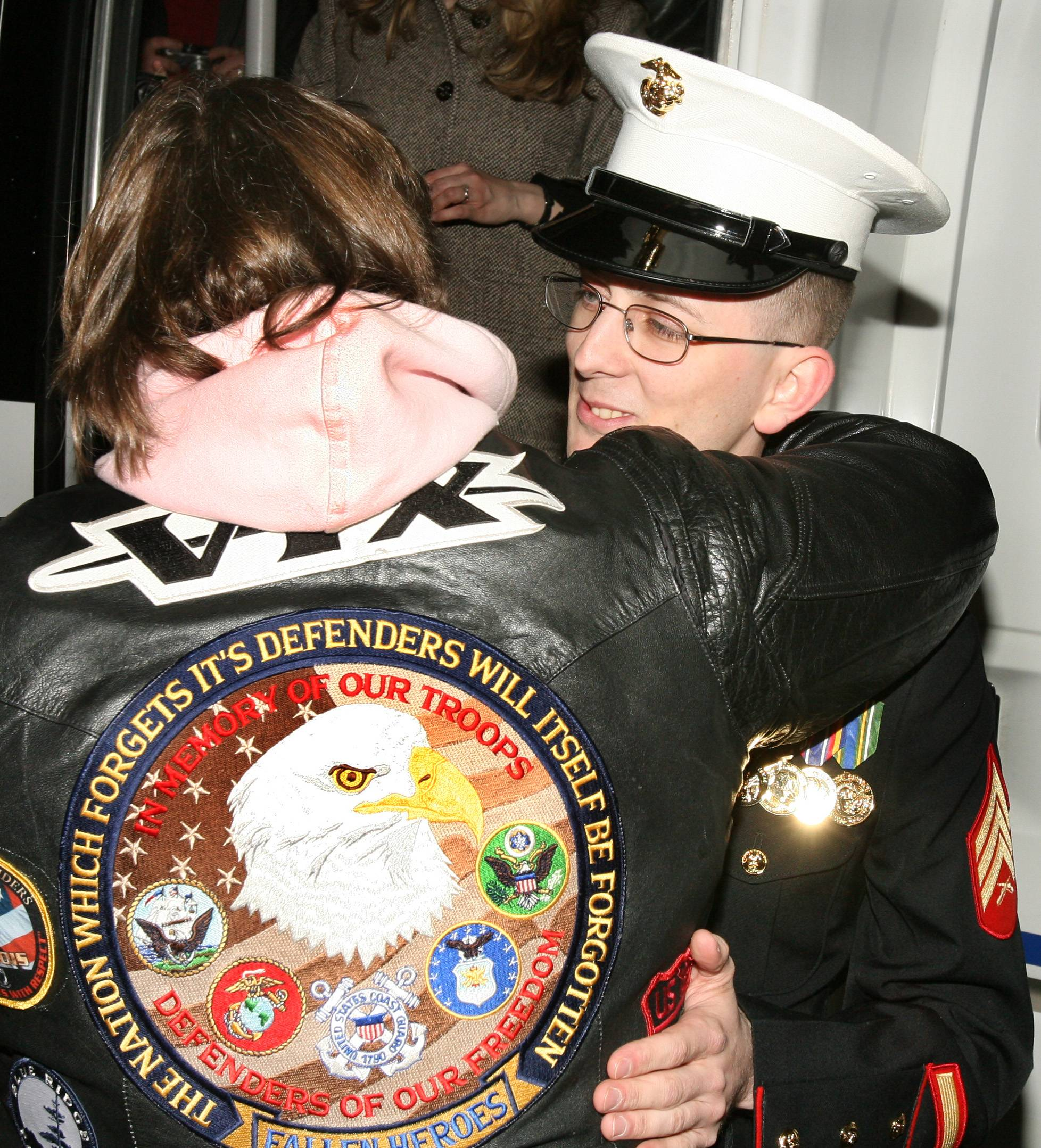 Marine Sgt Lee Bode, 27, is greeted at the Des Plaines Oasis and escorted to his Elk Grove home by Patriot Guard members and police.