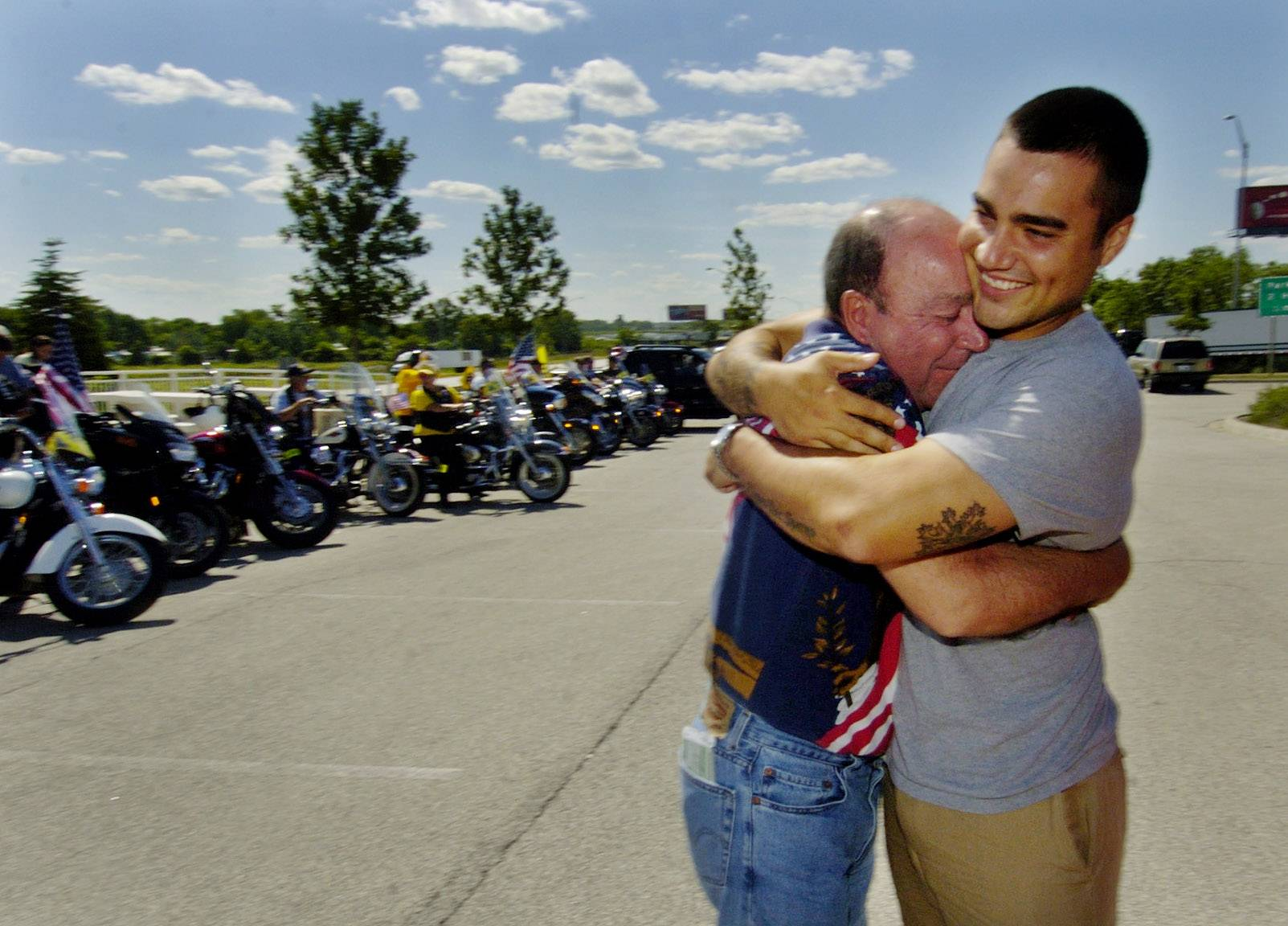 Palatine resident and U.S. Army SPC Patrick O'Connor returning home on leave being greeted by the Patriot Guard Riders at the Des Plaines oasis. Here he's greeted by his dad, Michael O'Connor.