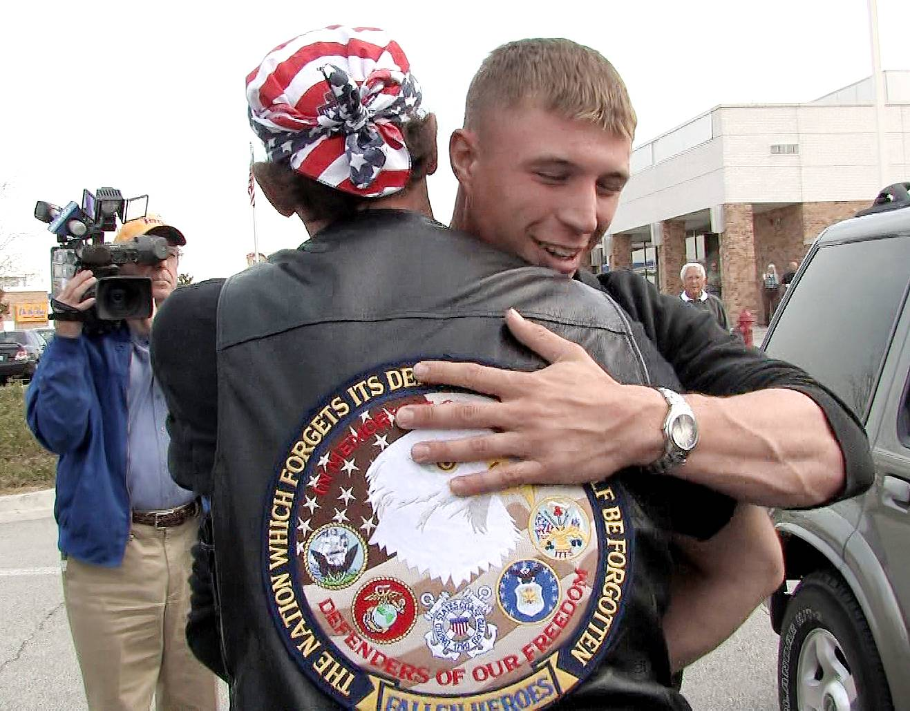Palatine Marine Jeff Francis is welcomed home from Iraq by a member of The Patriot Guard Riders at the Des Plaines Oasis. The group escorts members of the military returning home from over seas.