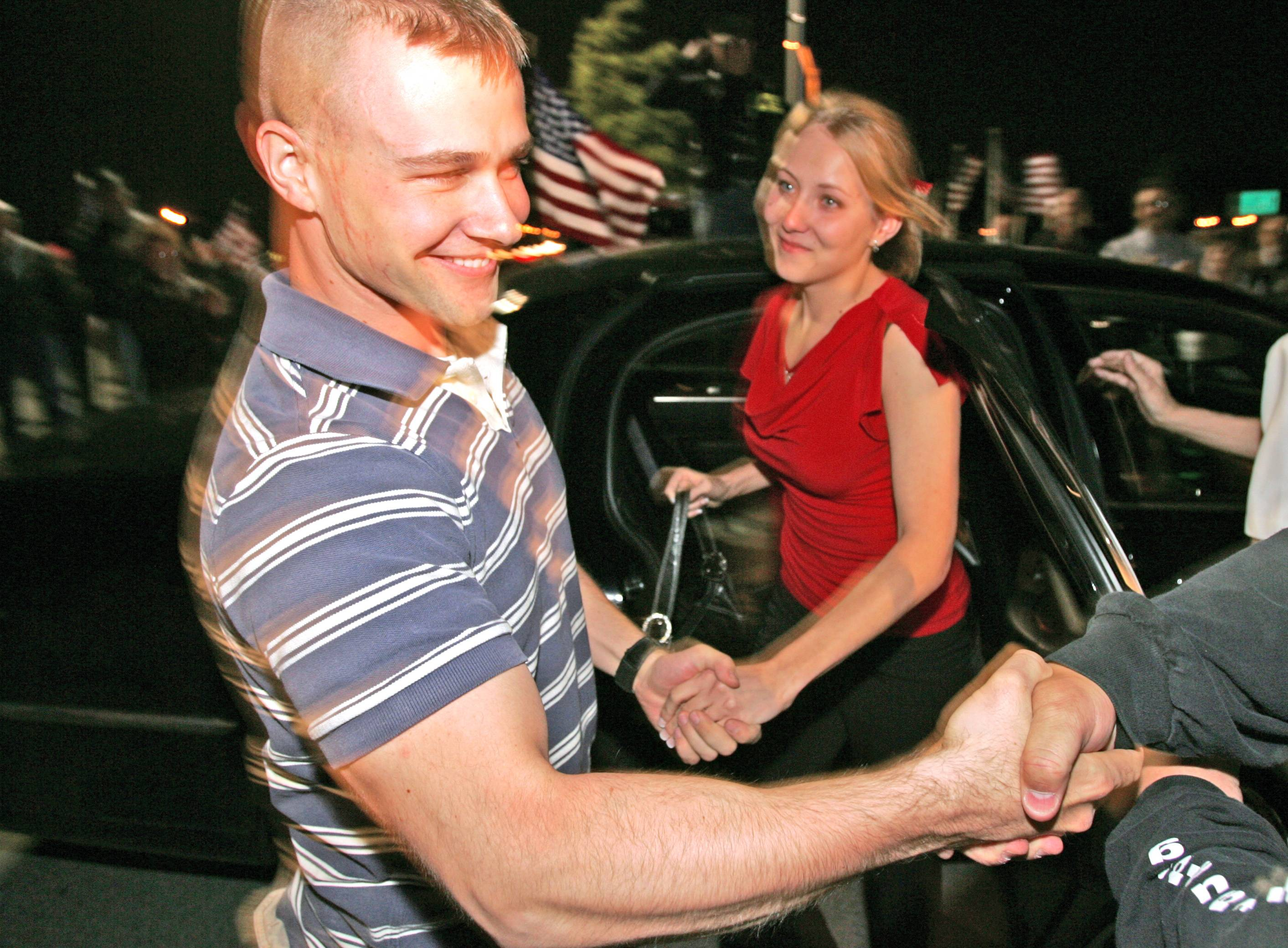 Christopher Lindahl, a first lieutenant with the U.S. Marine Corps, returned from Afghanistan and is greeted at the Illinois Tollway Des Plaines Oasis. He exits the car with his fiance Justyna Kurowska. Members of the Patriot Guard riders escorted him back to Lake Zurich.
