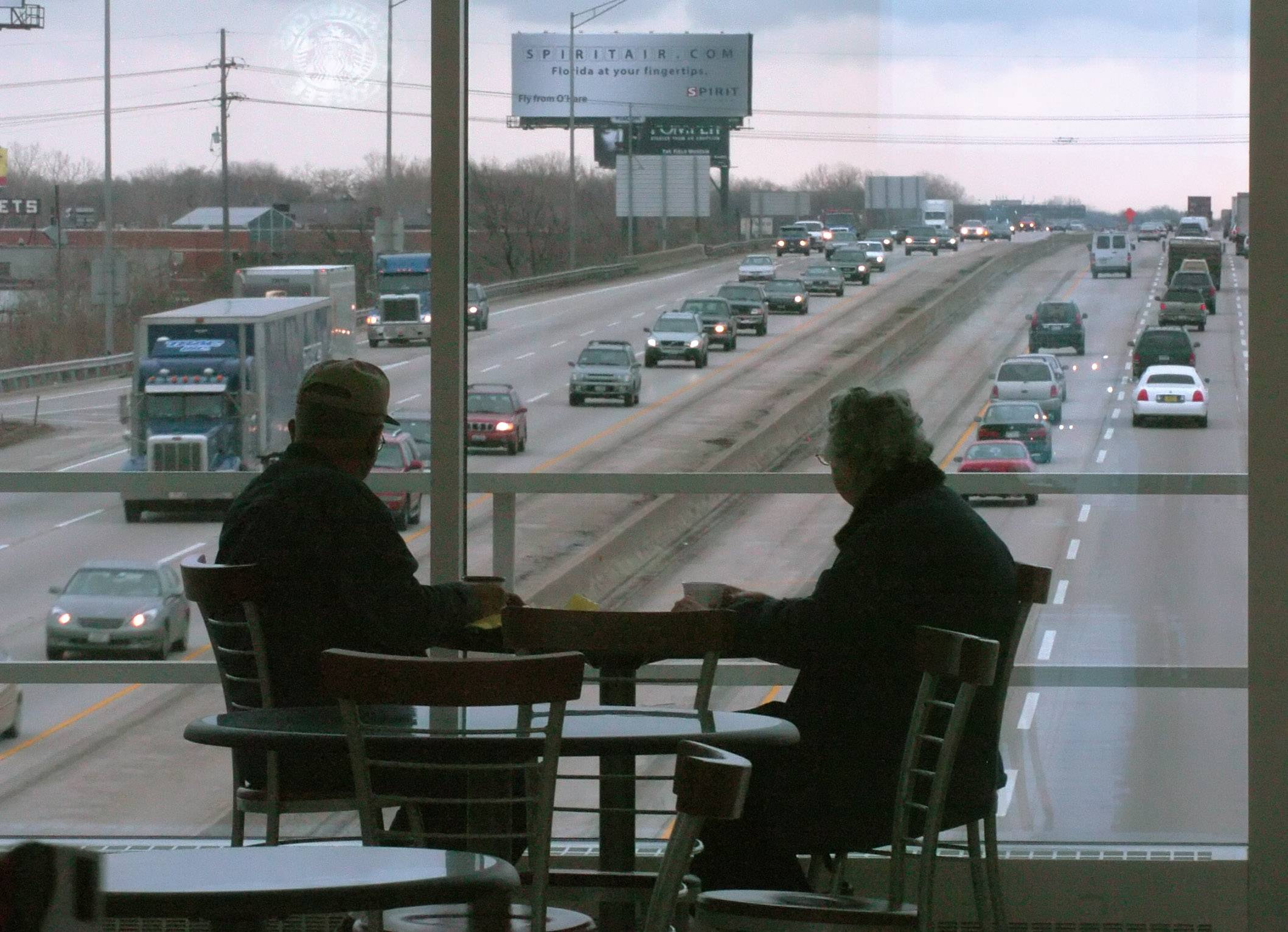 Traffic speeds by diners at the Des Plaines Oasis on the Interstate 90. Investigators are looking into how one individual got the concessions at the tollway system oases.