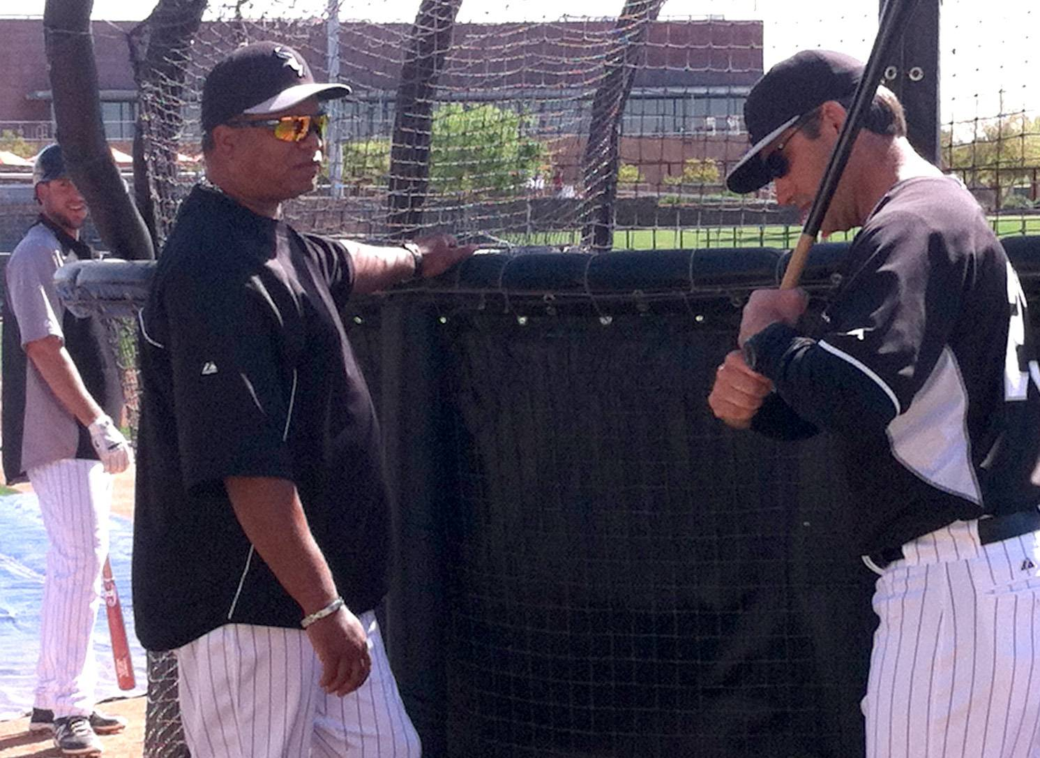 White Sox hitting coach Todd Steverson, left, gets ready for batting practice Friday afternoon at the team's spring training facility as manager Robin Ventura joins the discussion.