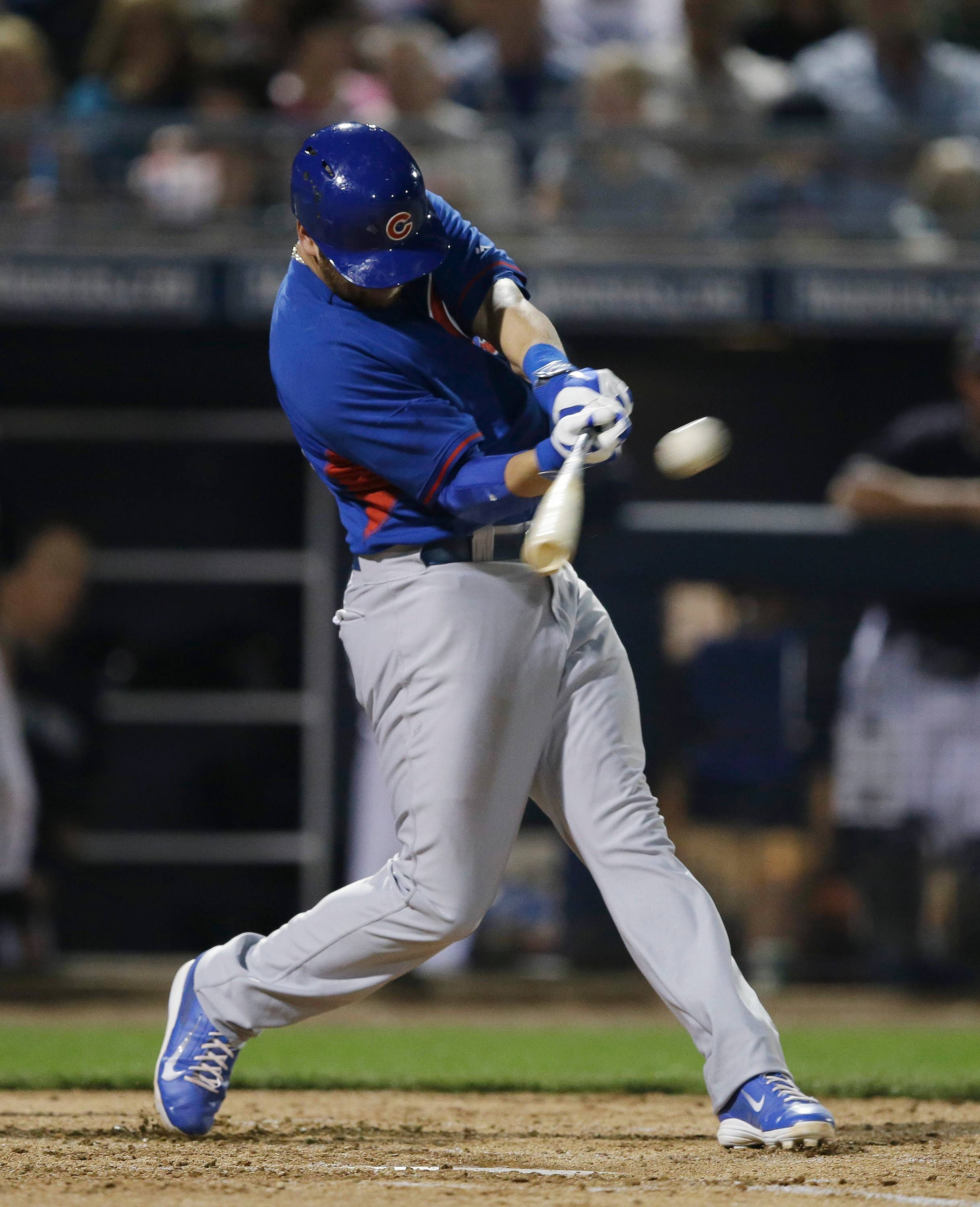 Mike Olt of the Chicago Cubs hits a solo home run during the second inning of a spring exhibition game against Mariners on Wednesday. He added another home later in the game.