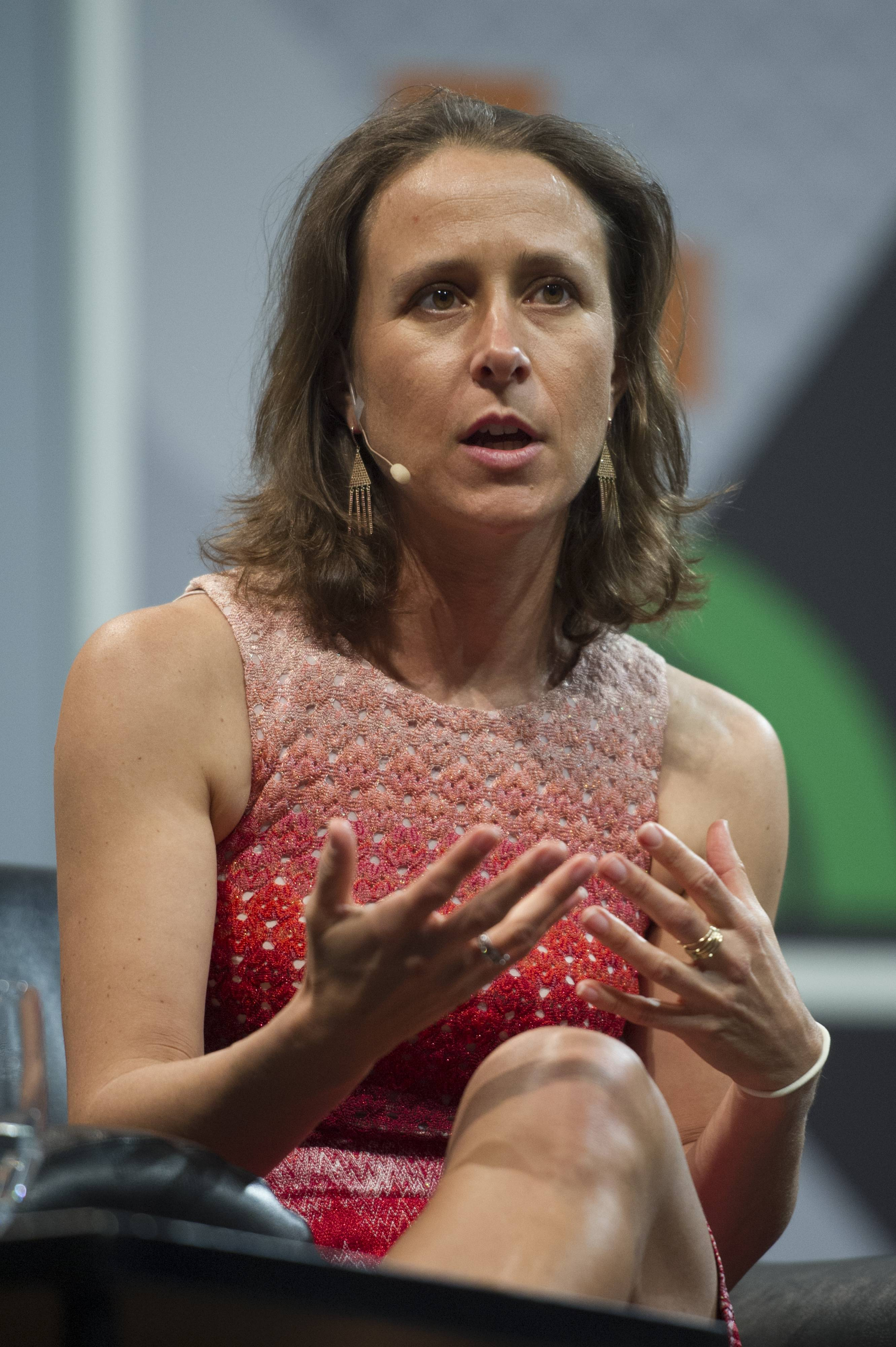 Anne Wojcicki, co-founder and chief executive officer of 23andMe, speaks during a keynote session at the South By Southwest (SXSW) Interactive Festival in Austin, Texas, U.S., on Sunday, March 9, 2014. The SXSW conferences and festivals converge original music, independent films, and emerging technologies while fostering creative and professional growth.
