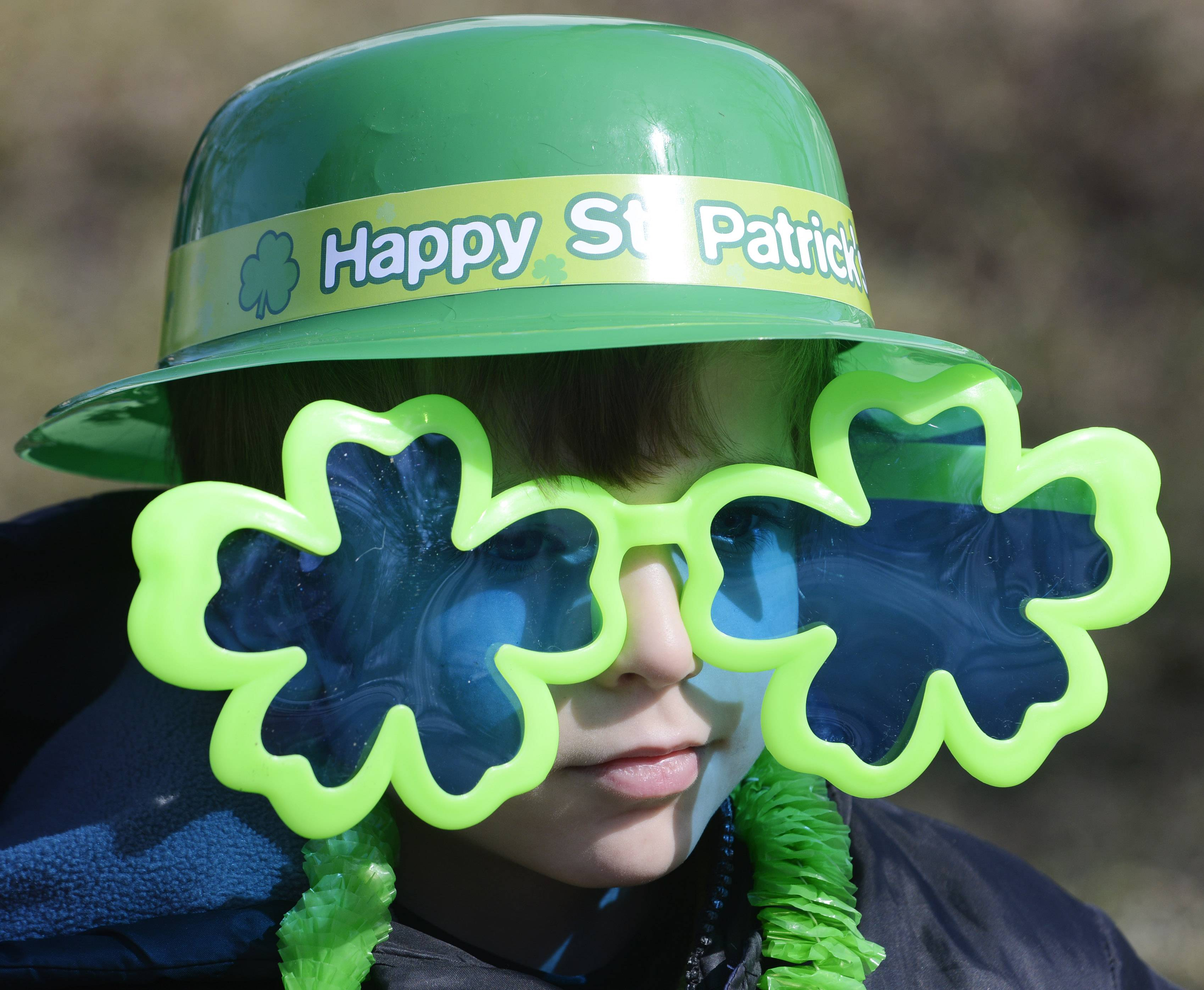 Gary Banser, 8, of Palatine awaits the start of the Palatine St. Patrick's Day Parade Saturday.
