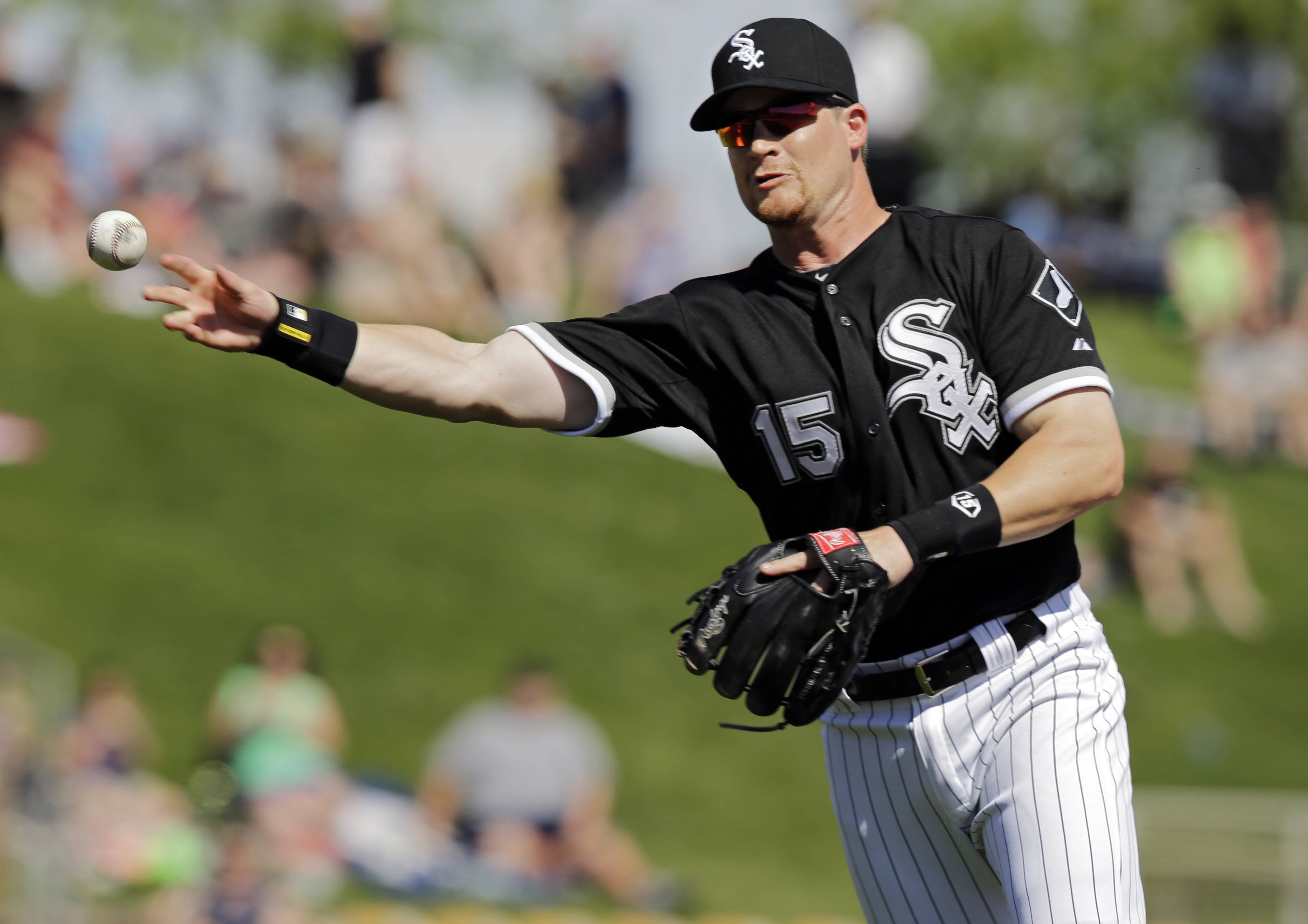 White Sox second baseman Gordon Beckham throws out a runner at first Friday, when he strained his left oblique on a swing after the game.