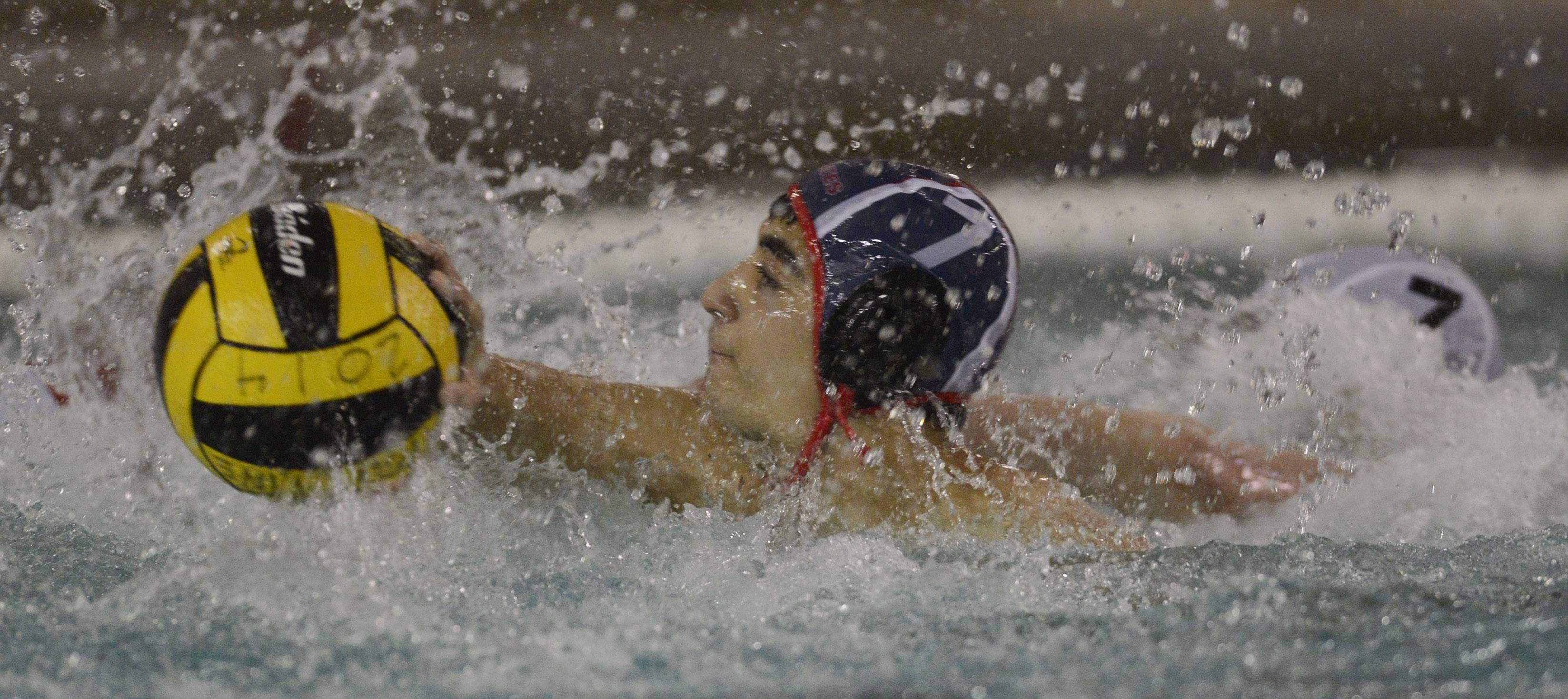 With the flick of his wrist, Palatine's Omar El Hoffi scores against McHenry during Saturday's water polo tournament at Palatine.