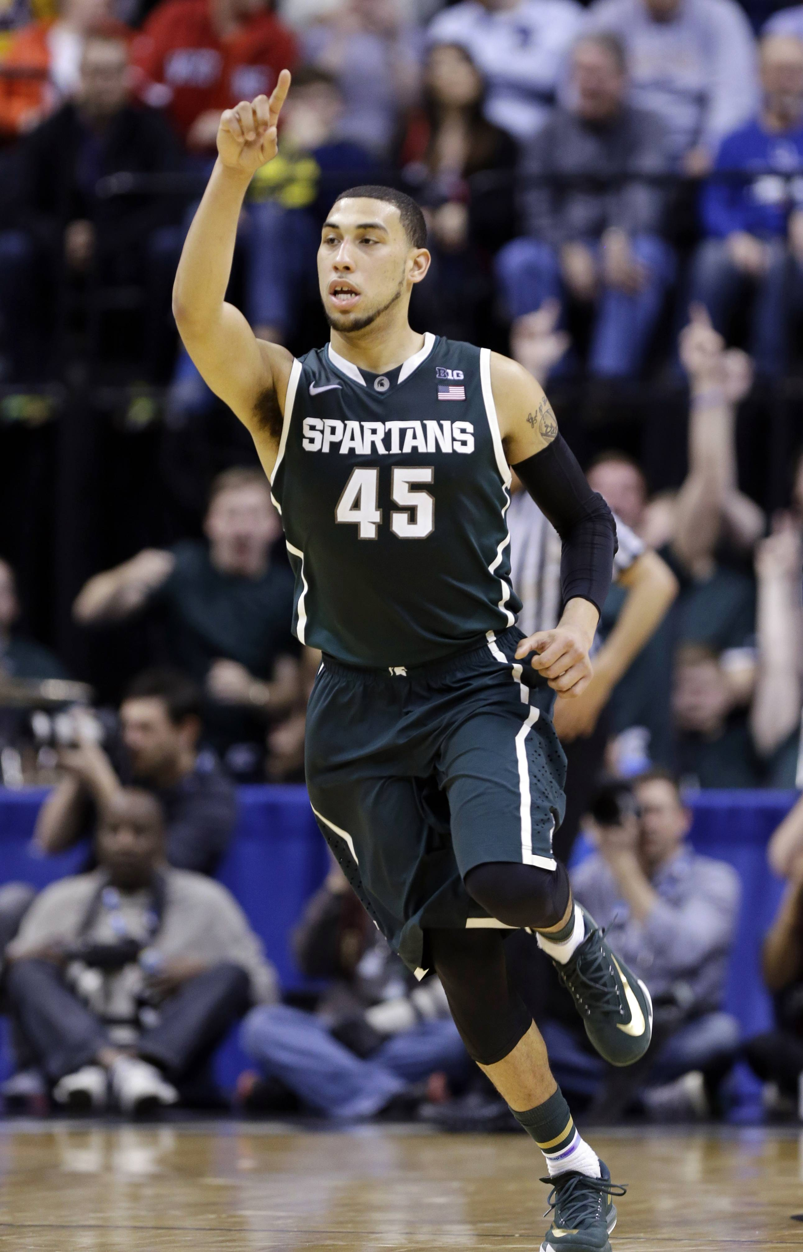 Michigan State guard Denzel Valentine and his Spartan teammates will play rival Michigan in the Big Ten tournament title game on Saturday.