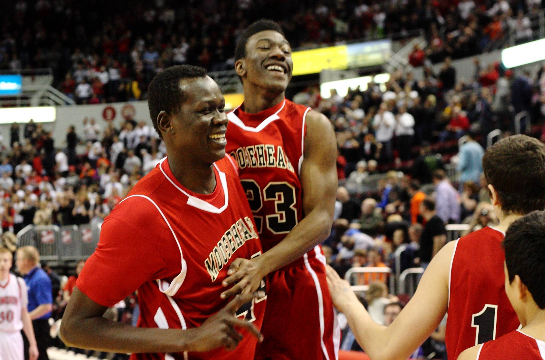 Mooseheart's Akim Nyang and Josh Tucker celebrate their Class A state title game victory over Heyworth in Peoria on Saturday. In their first final four appearance, the Red Ramblers brought home the basketball program's first state title after a 63-47 victory.