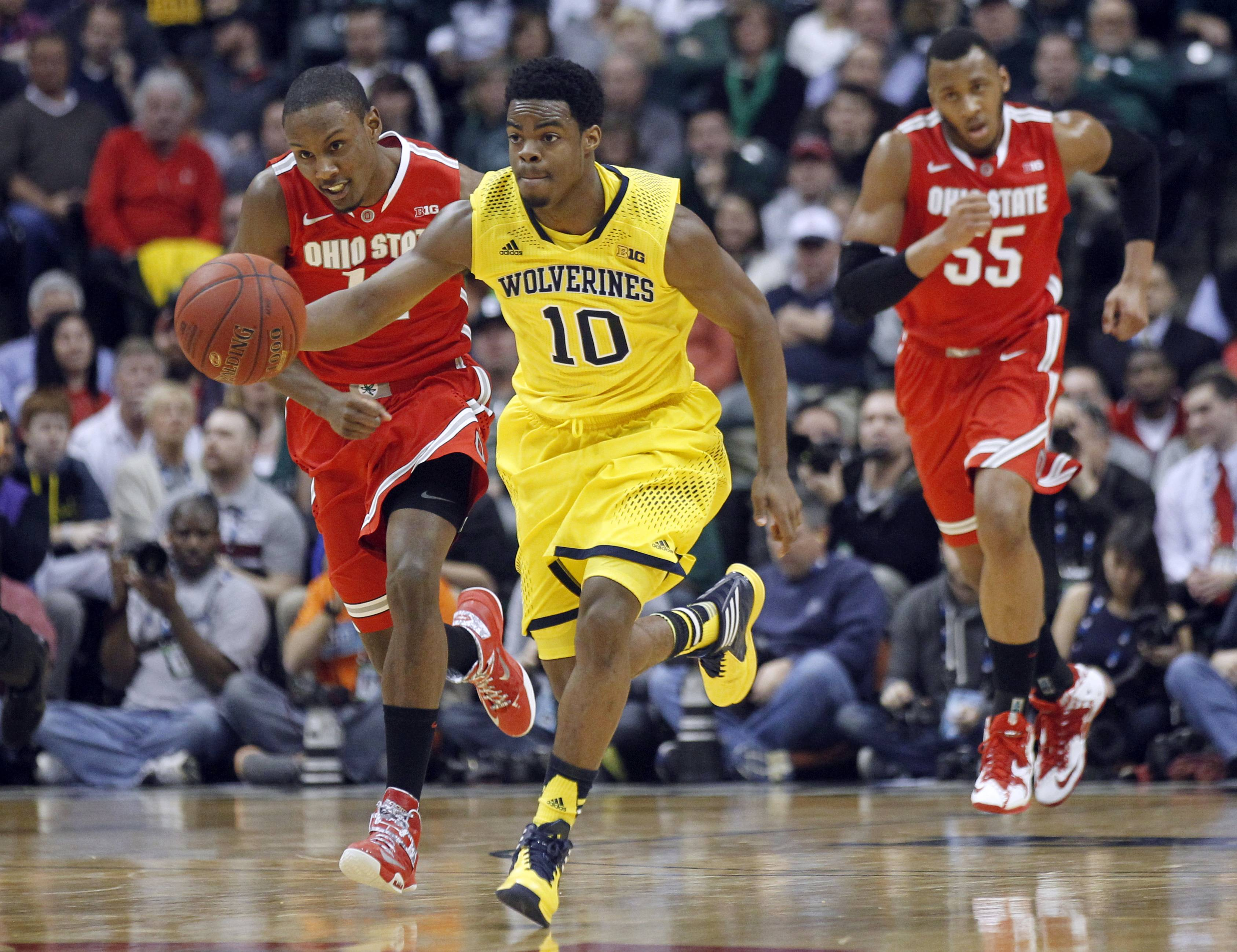 Michigan guard Derrick Walton Jr. drives the ball against Ohio State in the semifinals of the Big Ten Conference tournament Saturday in Indianapolis. Michigan won 72-69.