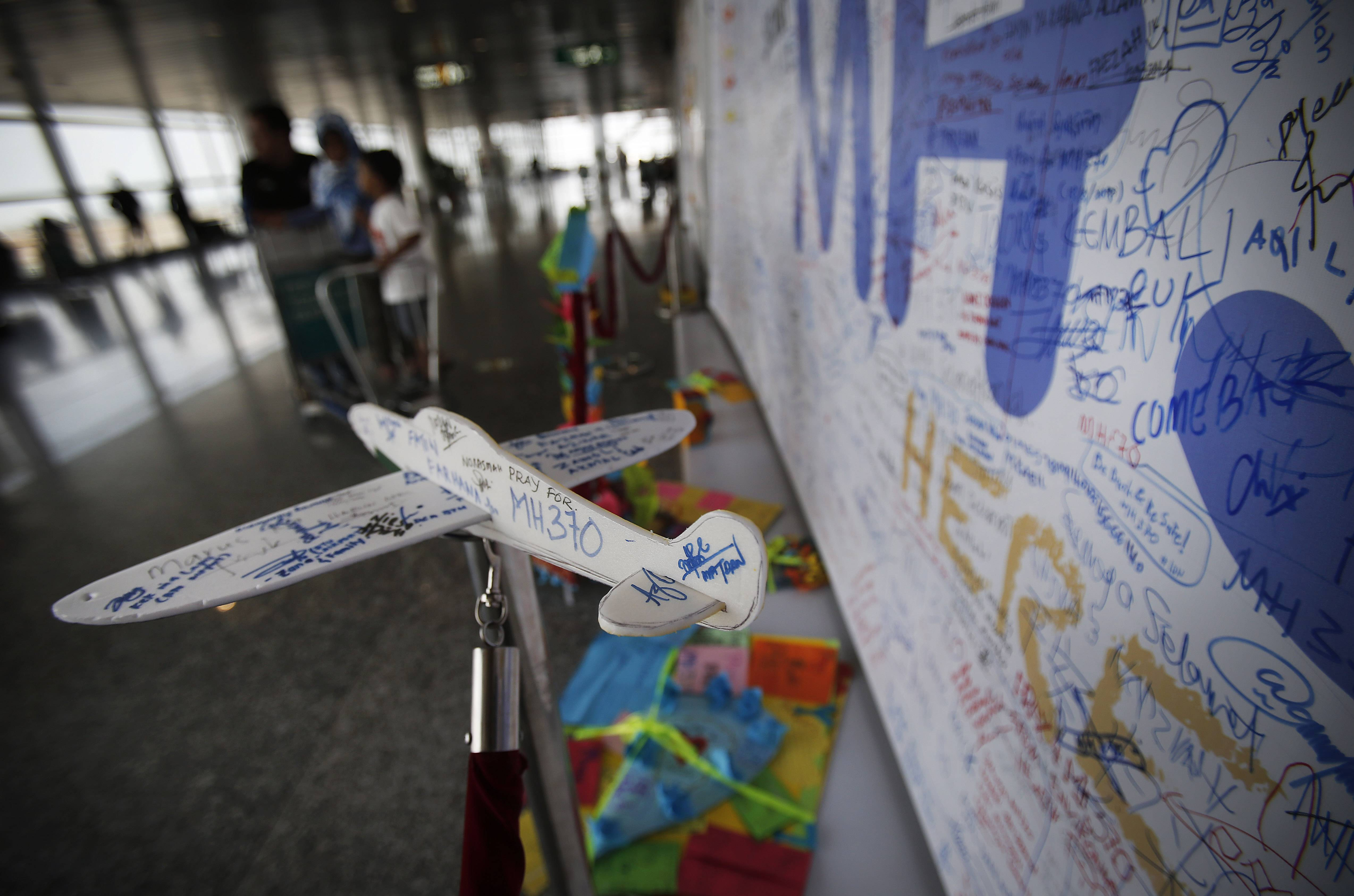 A foam plane with messages and cards with personalized messages dedicated to people involved with the missing Malaysia Airlines jetliner MH370, are placed in the viewing gallery at Kuala Lumpur International Airport, Saturday, March 15, 2014 in Sepang, Malaysia. A Malaysian passenger jet missing for more than a week had its communications deliberately disabled and its last signal came about seven and a half hours after takeoff, meaning it could have ended up as far as Kazakhstan or deep in the southern Indian Ocean, Malaysia's Prime Minister Najib Razak said Saturday.