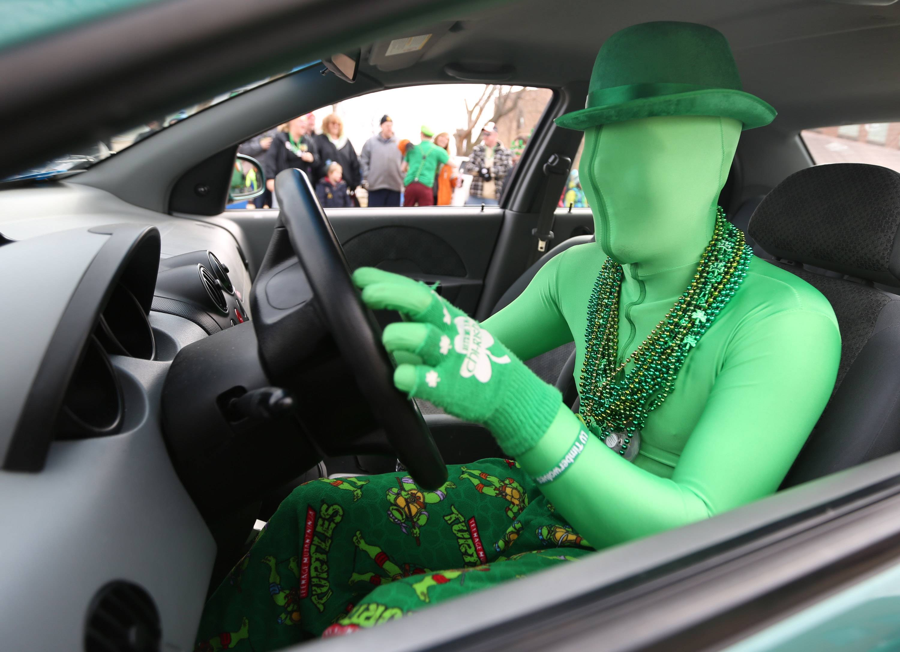 Ryan Coy of Lake Villa drives Blackthorn Grille's car in the Village of Lake Villa's St. Patrick's Day Parade on Saturday.