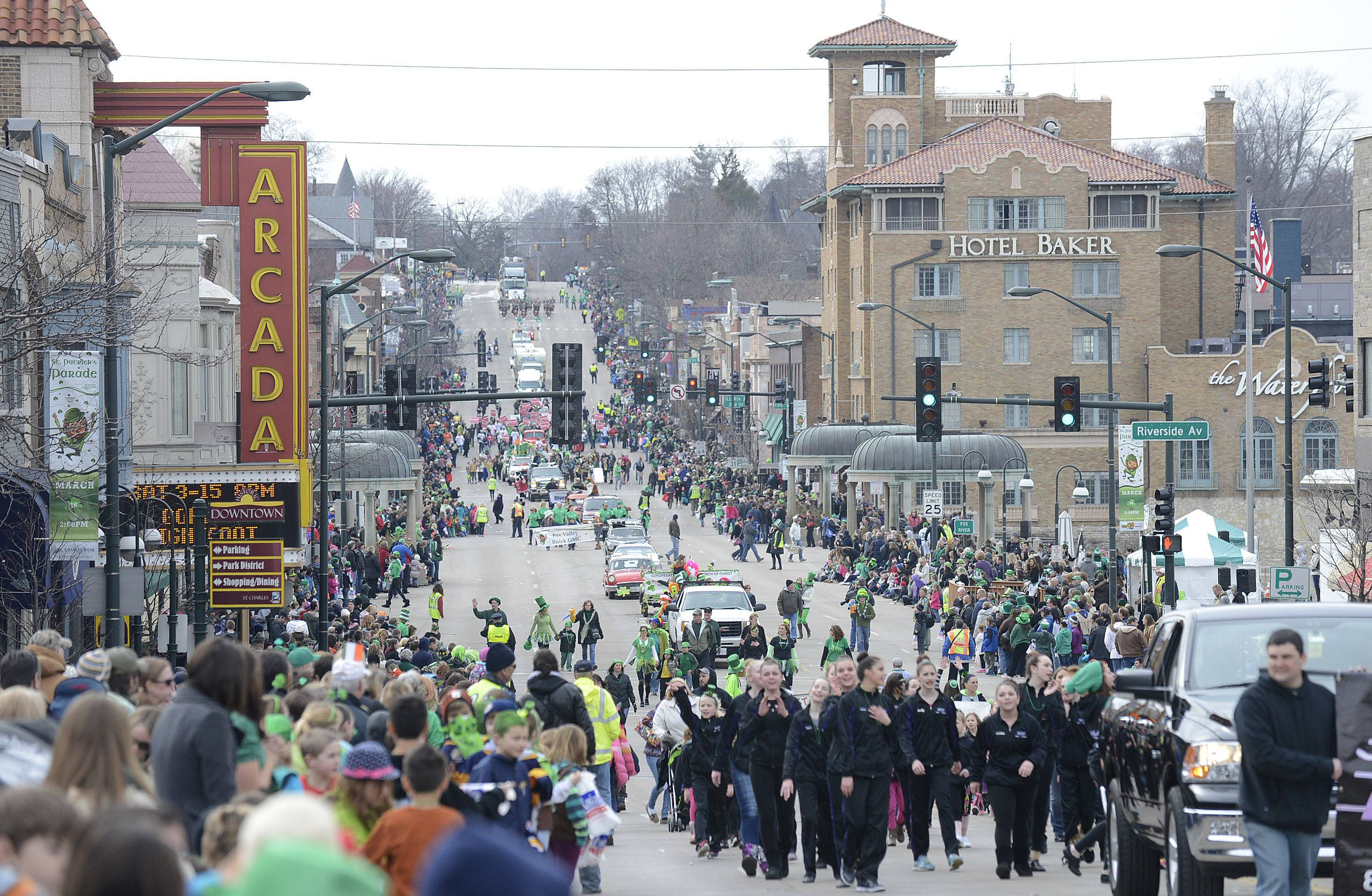 Groups make their way eastbound on Main Street in downtown St. Charles during town's annual St. Patrick's Day parade on Saturday, March 15.