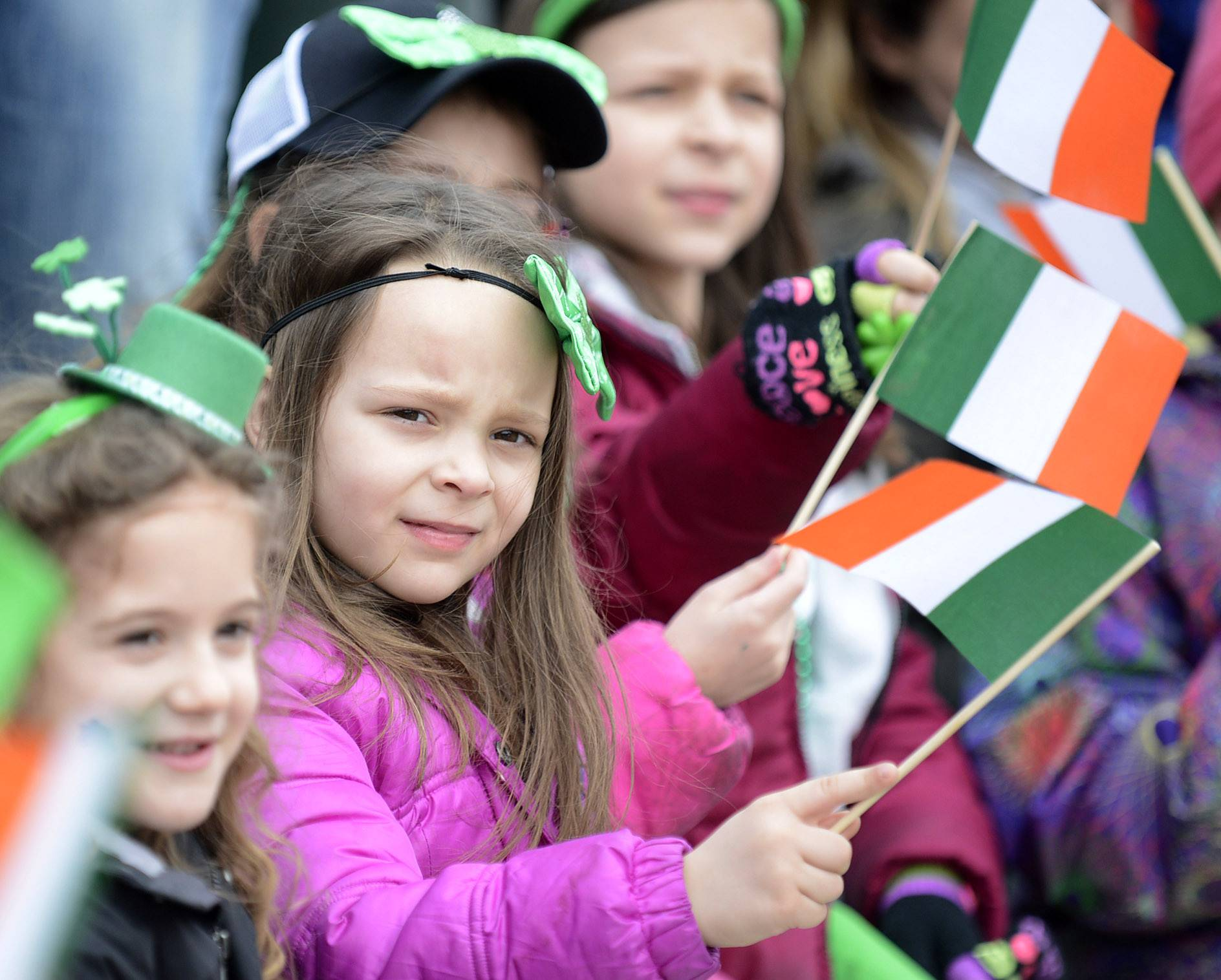 Meghan Manini, 5, of St. Charles watches the St. Patrick's Day parade make its way down Main Street in St. Charles on Saturday.