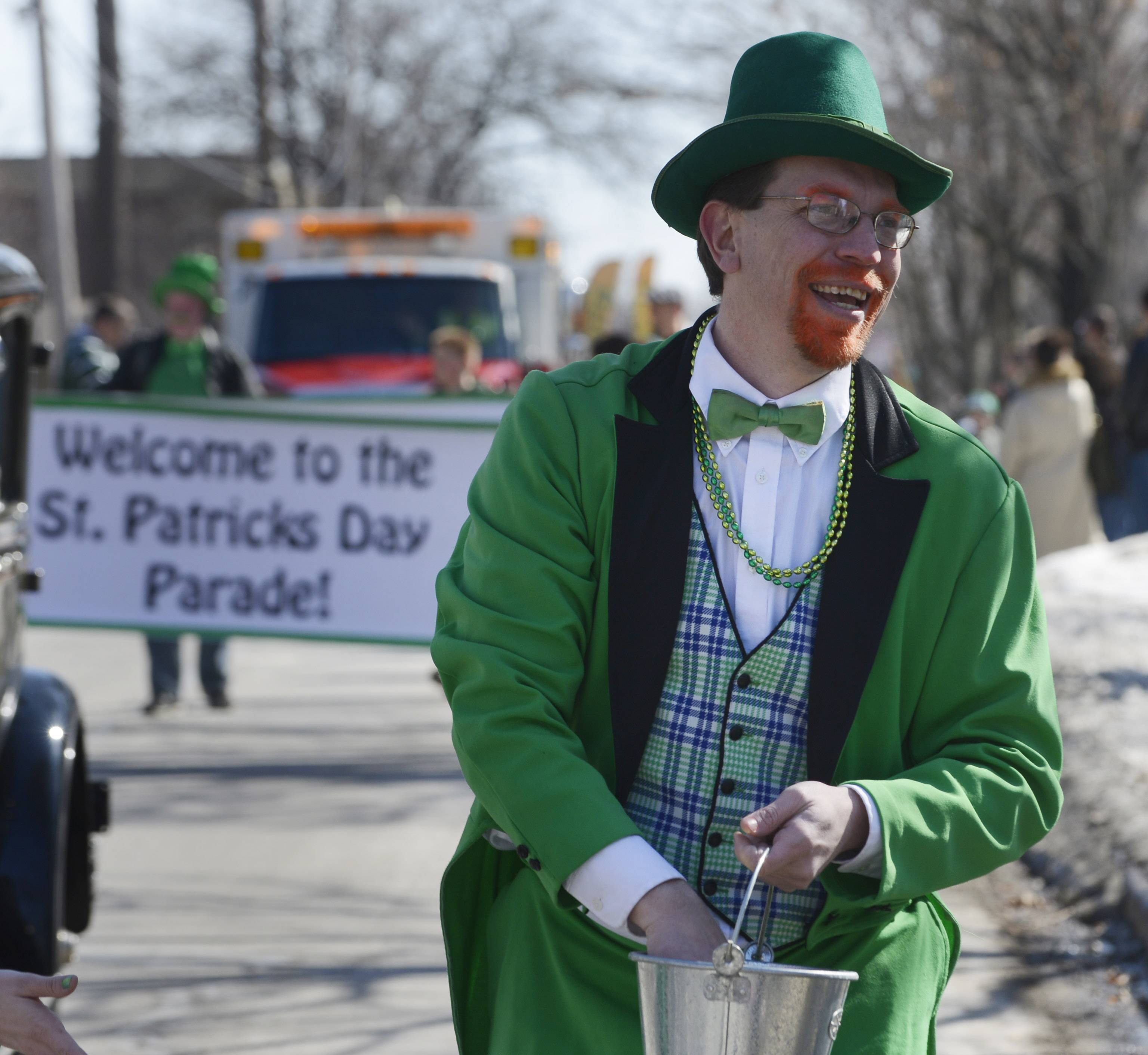 "Parade Grand Marshal Jason Foltyn, aka ""Lucky McClover,"" distributes beads and candy during the Palatine St. Patrick's Day Parade Saturday."