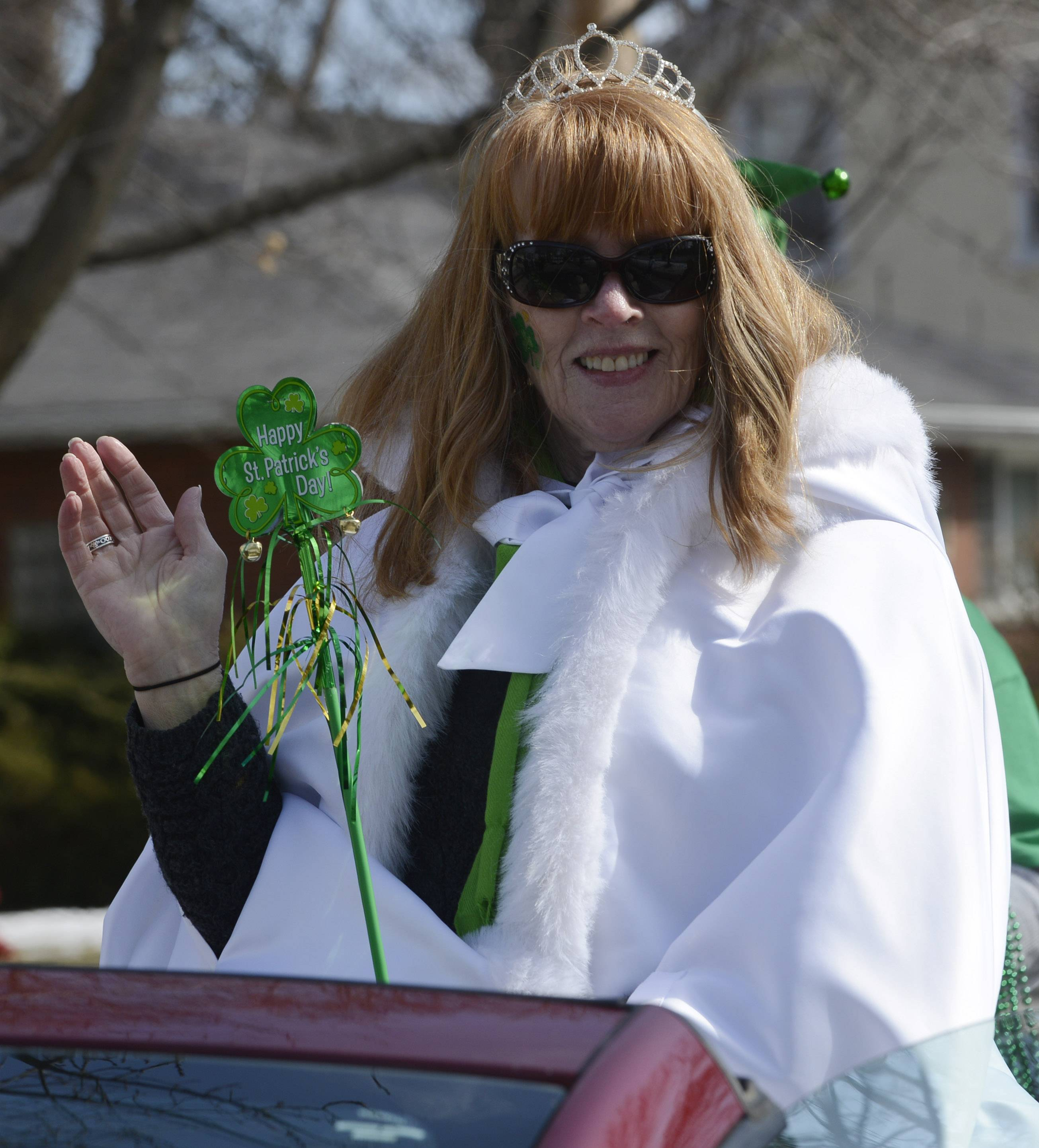 Queen Kathleen Moore-Nyczaj waves to the crowd during the Palatine St. Patrick's Day Parade Saturday.