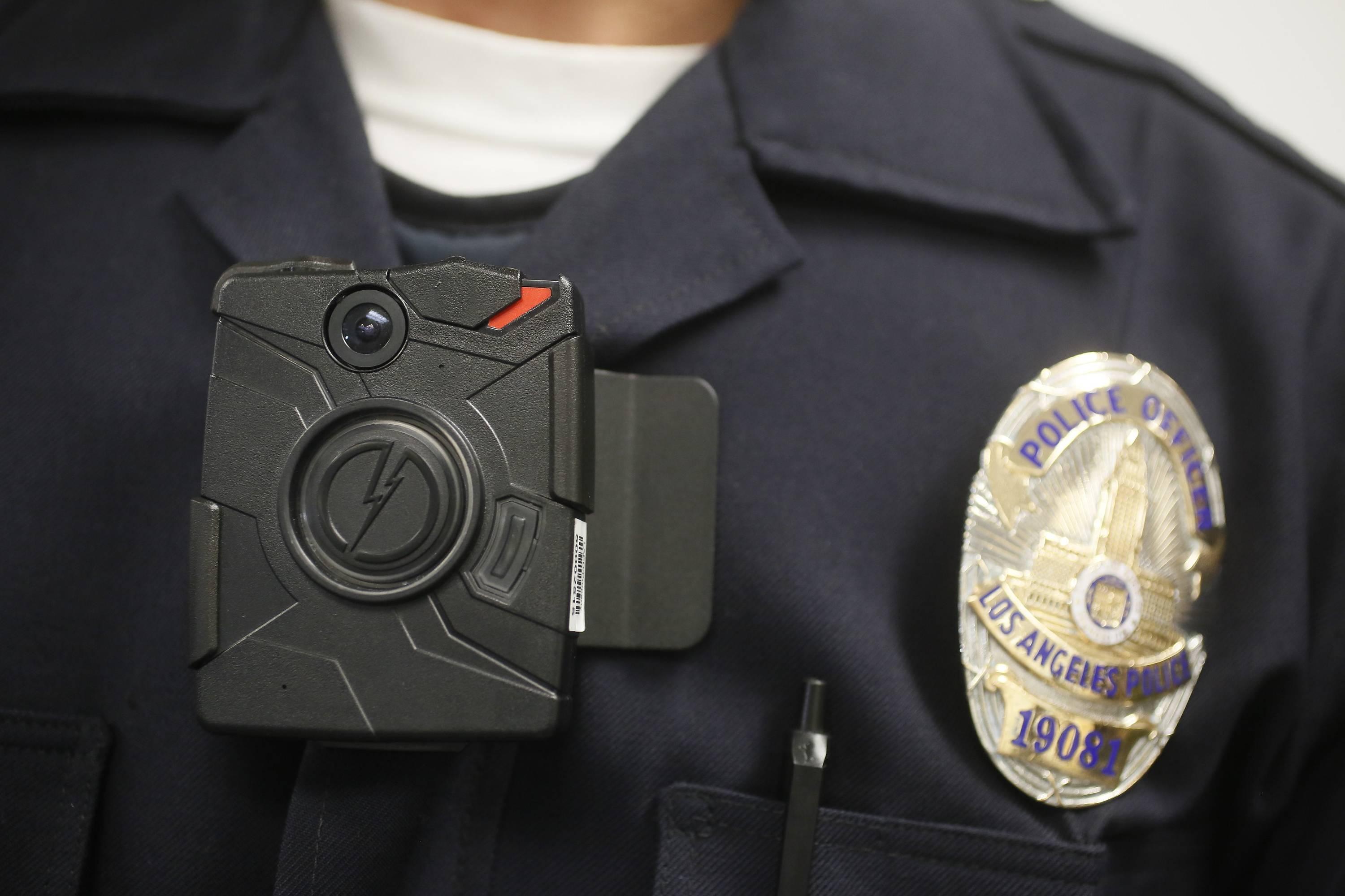 This Jan. 15, 2014 file photo shows a Los Angeles Police officer wearing an on-body cameras during a demonstration for media in Los Angeles. Thousands of police agencies have equipped officers with cameras to wear with their uniforms, but they've frequently lagged in setting policies on how they're used, potentially putting privacy at risk and increasing their liability. As officers in one of every six departments across the nation now patrols with tiny lenses on their chests, lapels or sunglasses, administrators and civil liberties experts are trying to envision and address troublesome scenarios that could unfold in front of a live camera.