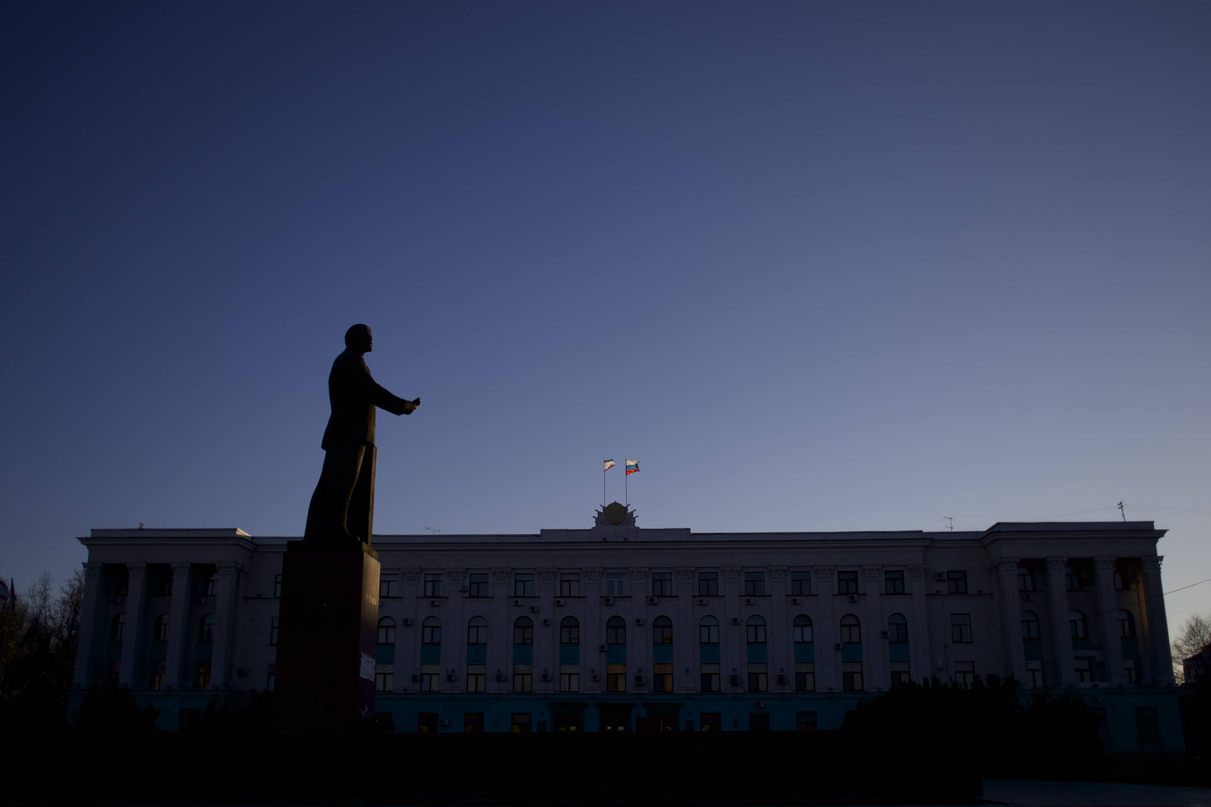 Russian and Crimean flags fly over local government building as Soviet Union founder Vladimir Lenin's statue dominates over landscape in downtown in Simferopol, Ukraine, on Saturday, March 15. Tensions are high in the Black Sea peninsula of Crimea, where a referendum is to be held Sunday on whether to split off from Ukraine and seek annexation by Russia.