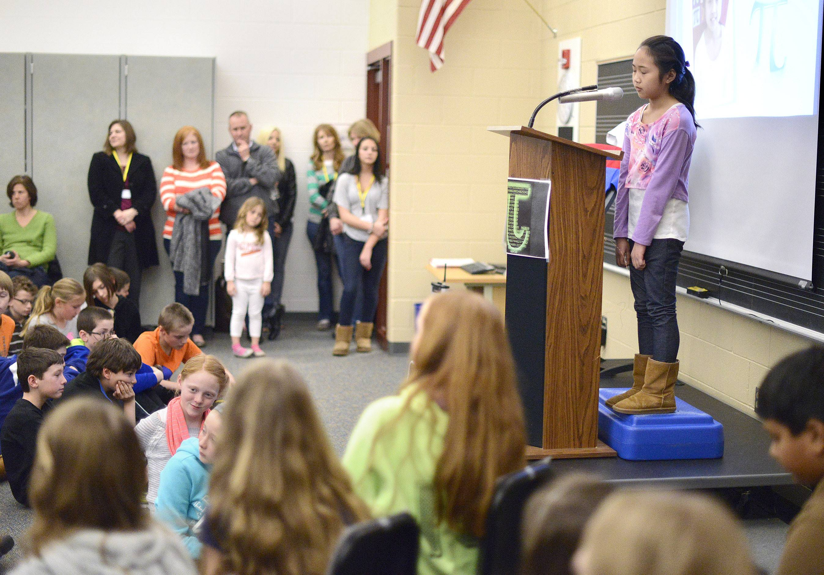 Fifth-grader Michelle Wang is a study in concentration as she recites the first 550 digits after the decimal point in pi (as in 3.14159) at Mill Creek Elementary School's Pi Day celebration in Geneva on Friday. Her effort shattered a school record.
