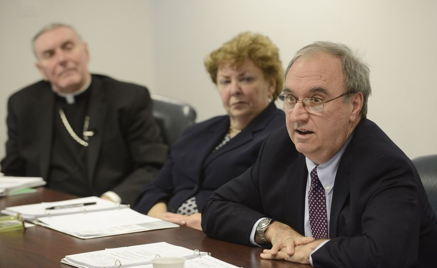 John O'Malley, right, director of legal services for the Archdiocese of Chicago, discusses how the archdiocese has responded to priest sex abuse. Seated with him are Bishop Francis Kane, vicar general for the archdiocese, and Jan Slattery, director of the Office for the Protection of Children and Youth.