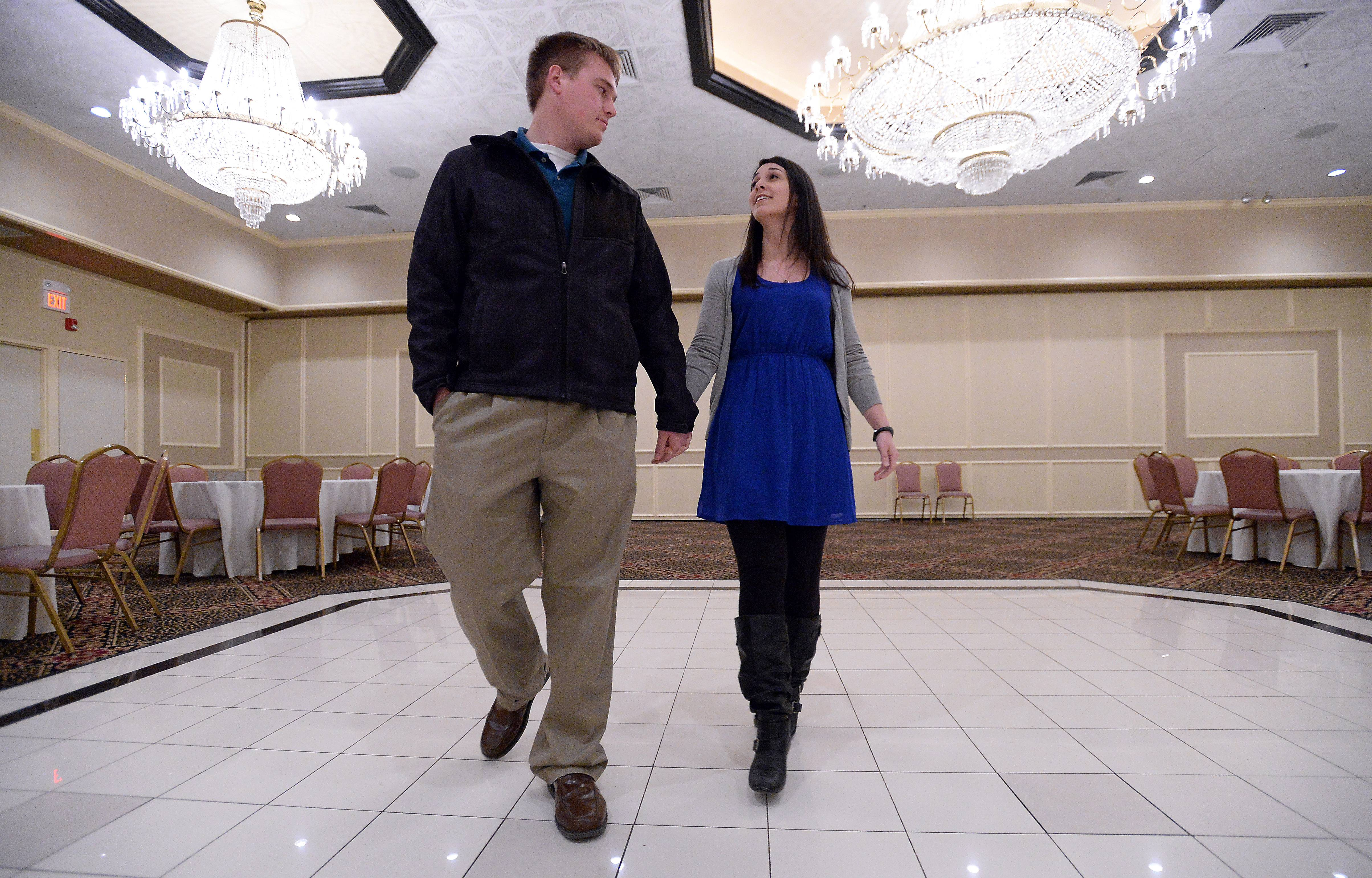 "John Mueller and Kelly Bayer check out the dance floor at their new venue, The Cotillion in Palatine. ""I hope this never happens to anyone else,"" Kelly Bayer said."