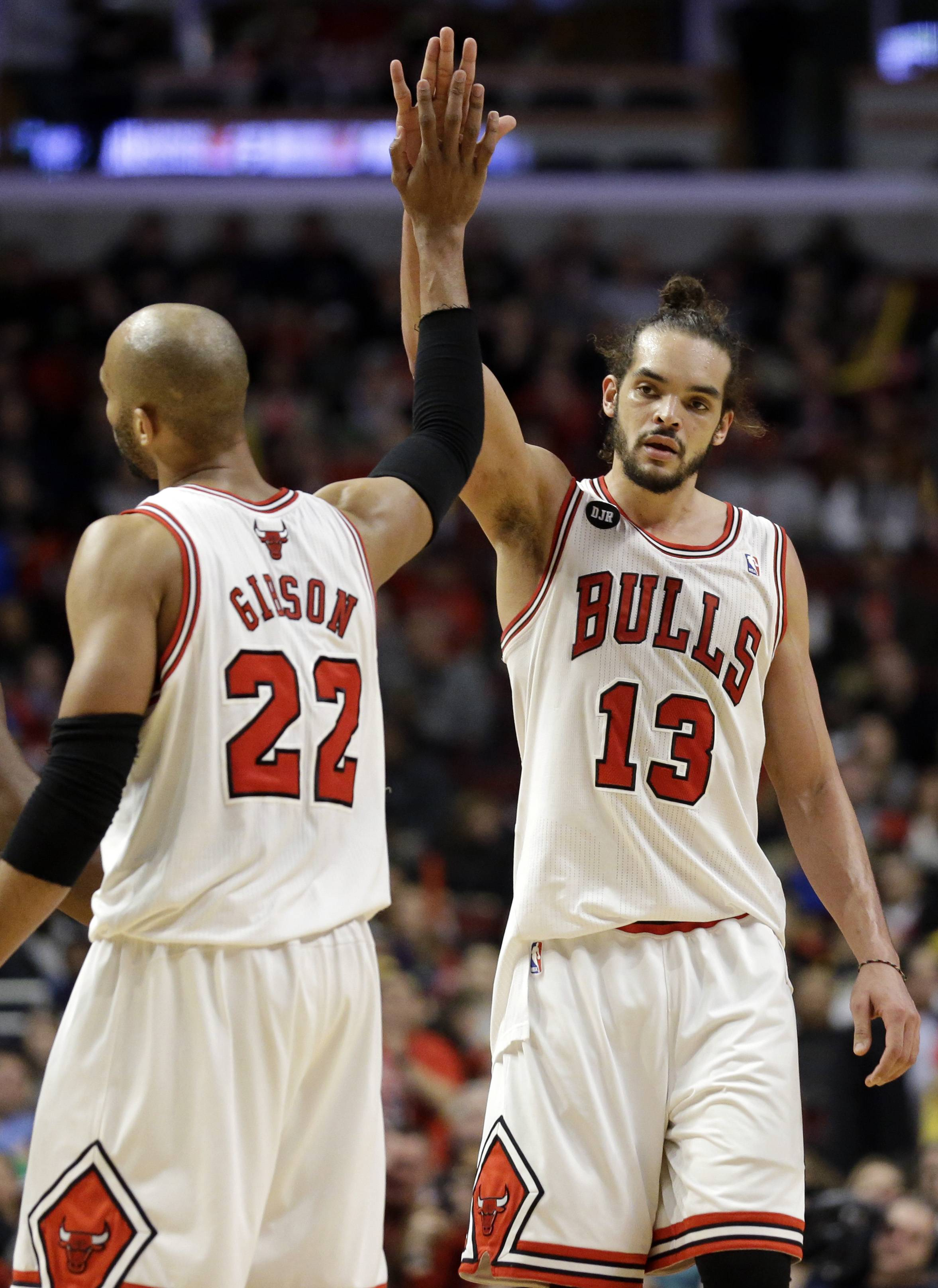 Bulls center Joakim Noah, right, celebrates with forward Taj Gibson after Gibson scored during the second half of Saturday's home game against the Sacramento Kings.