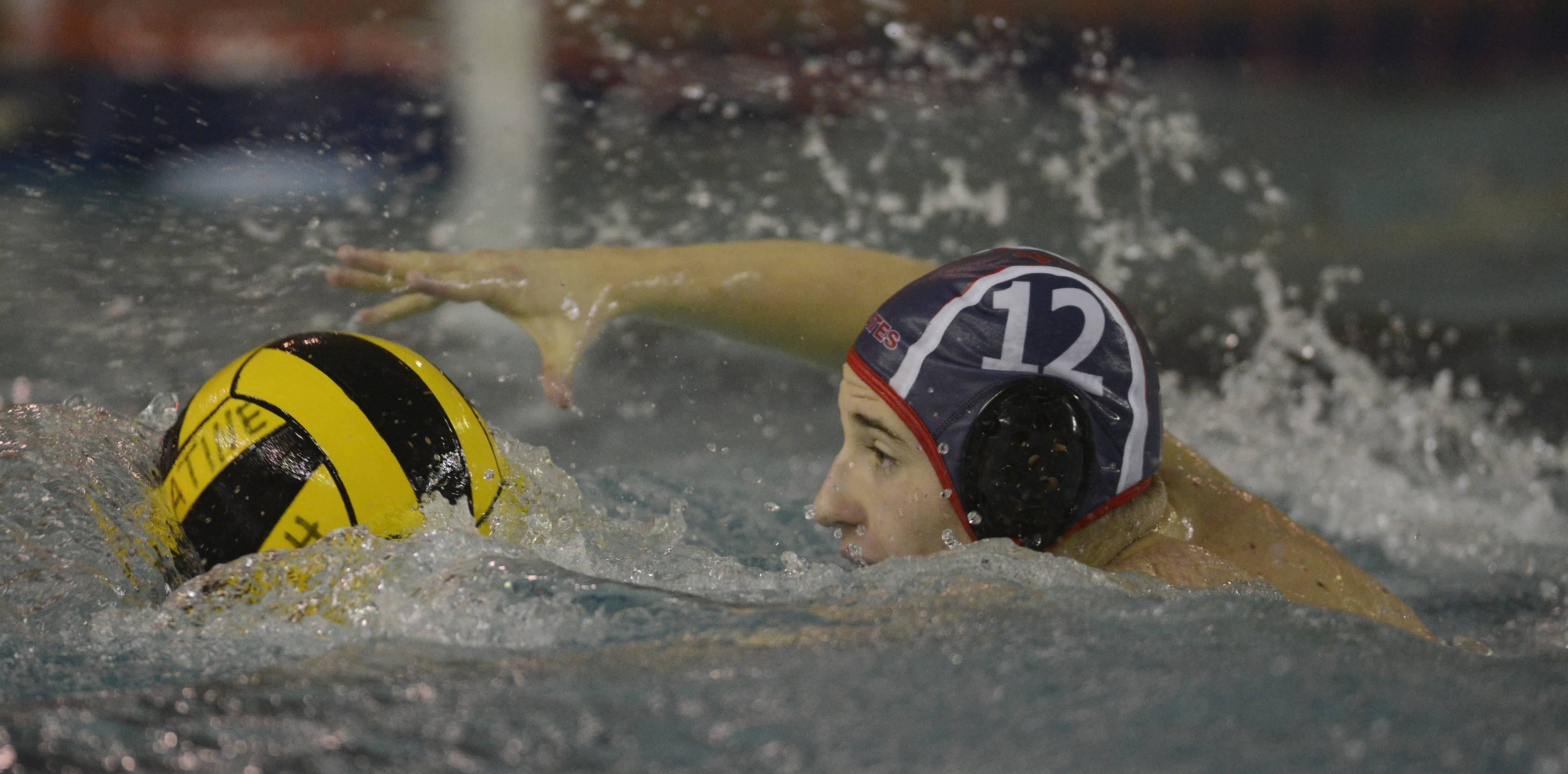 Palatine's Jacob Baran moves the ball on a fastbreak during Saturday's water polo tournament at Palatine.