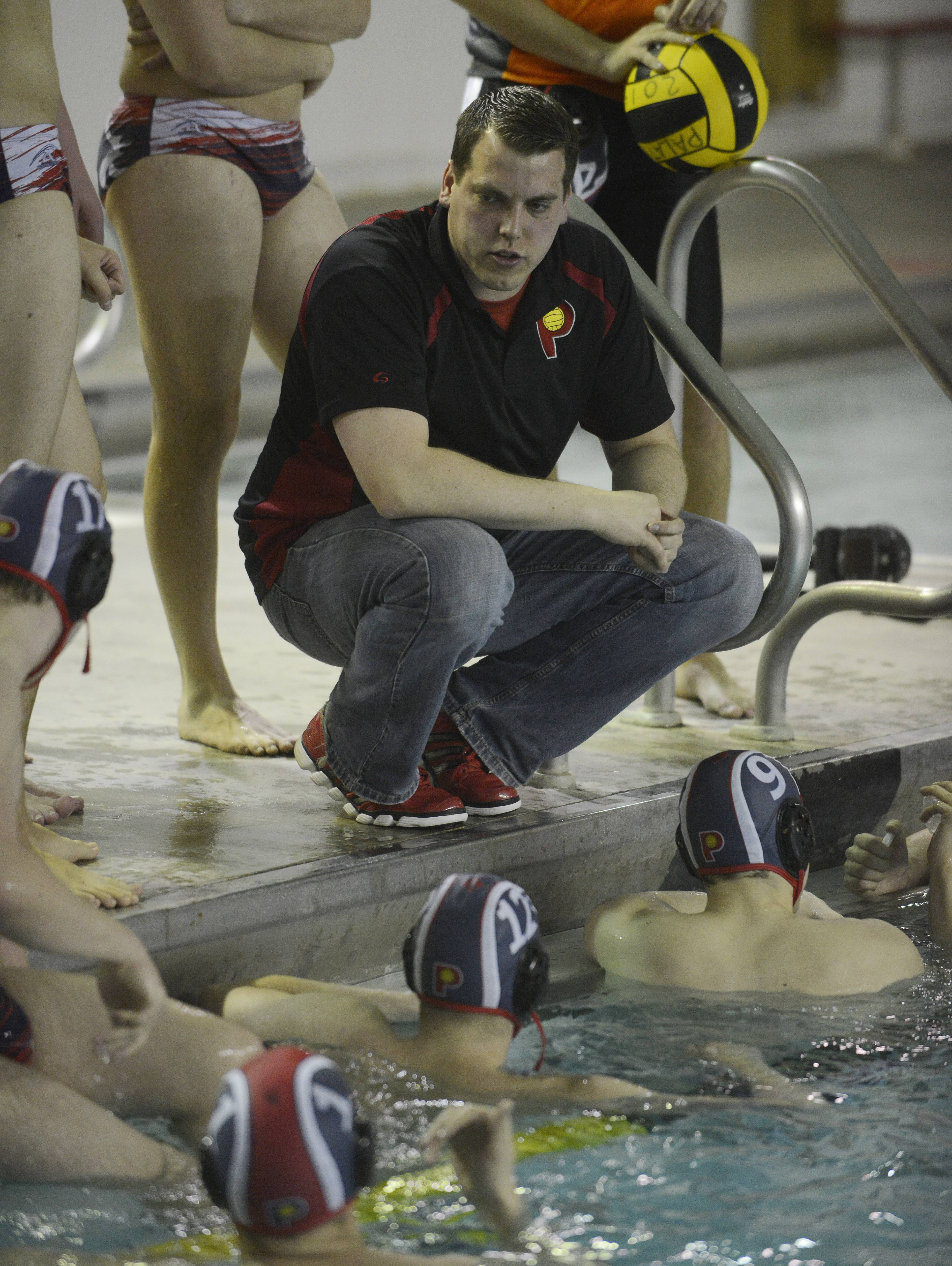 Palatine boys water polo coach Joe Grzybek talks to his team between quarters during Saturday's water polo tournament at Palatine.