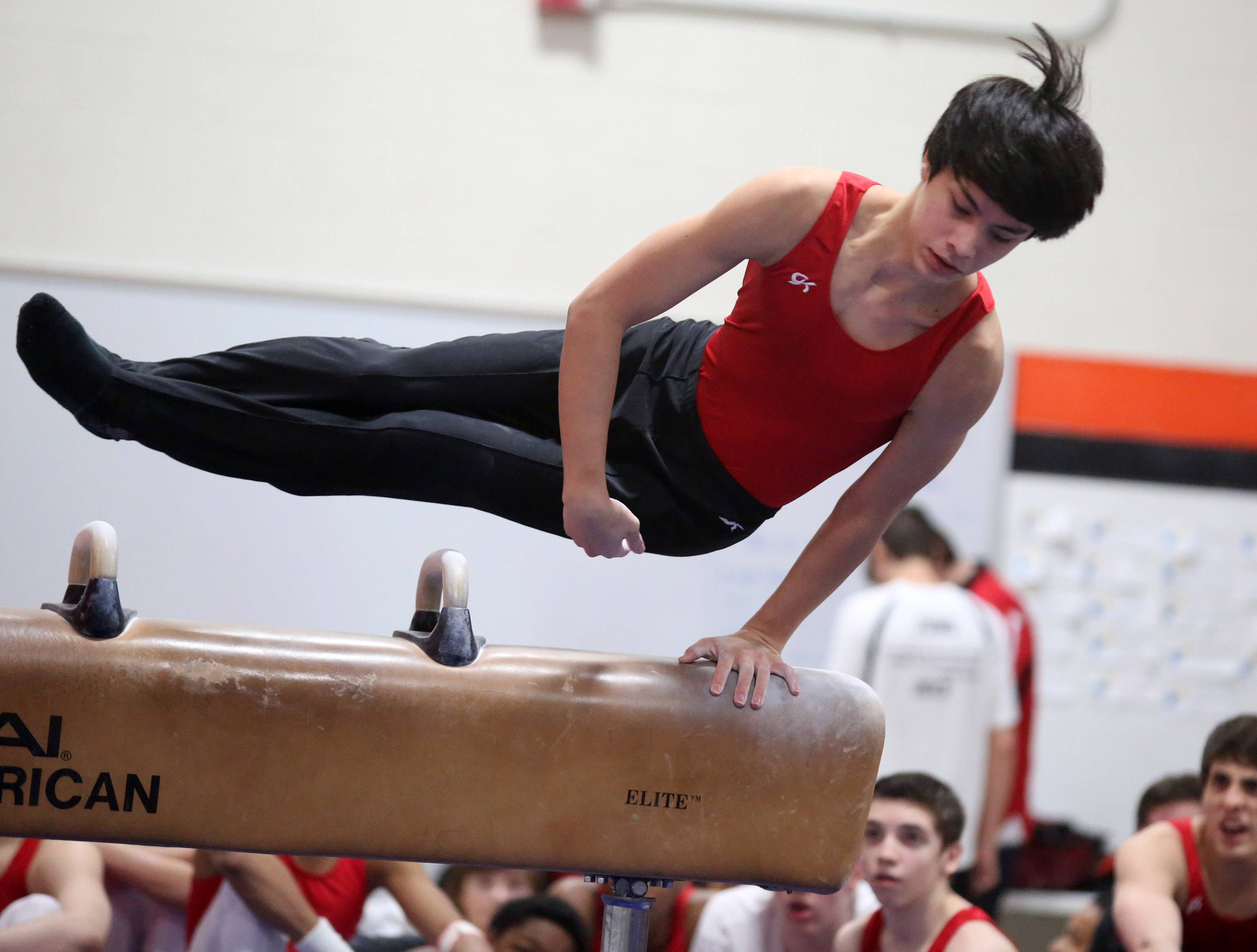 Naperville Central's Keenan Oshiro competes on pommel horse on Saturday at Libertyville.
