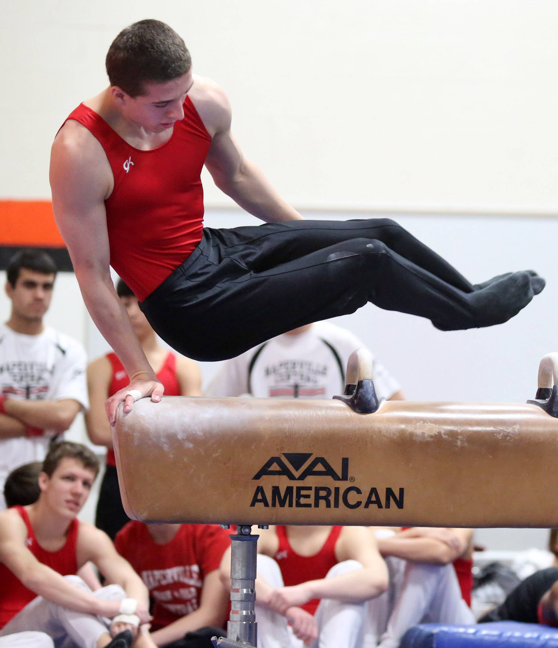 Naperville Central's Joe Bajek competes on pommel horse on Saturday at Libertyville.