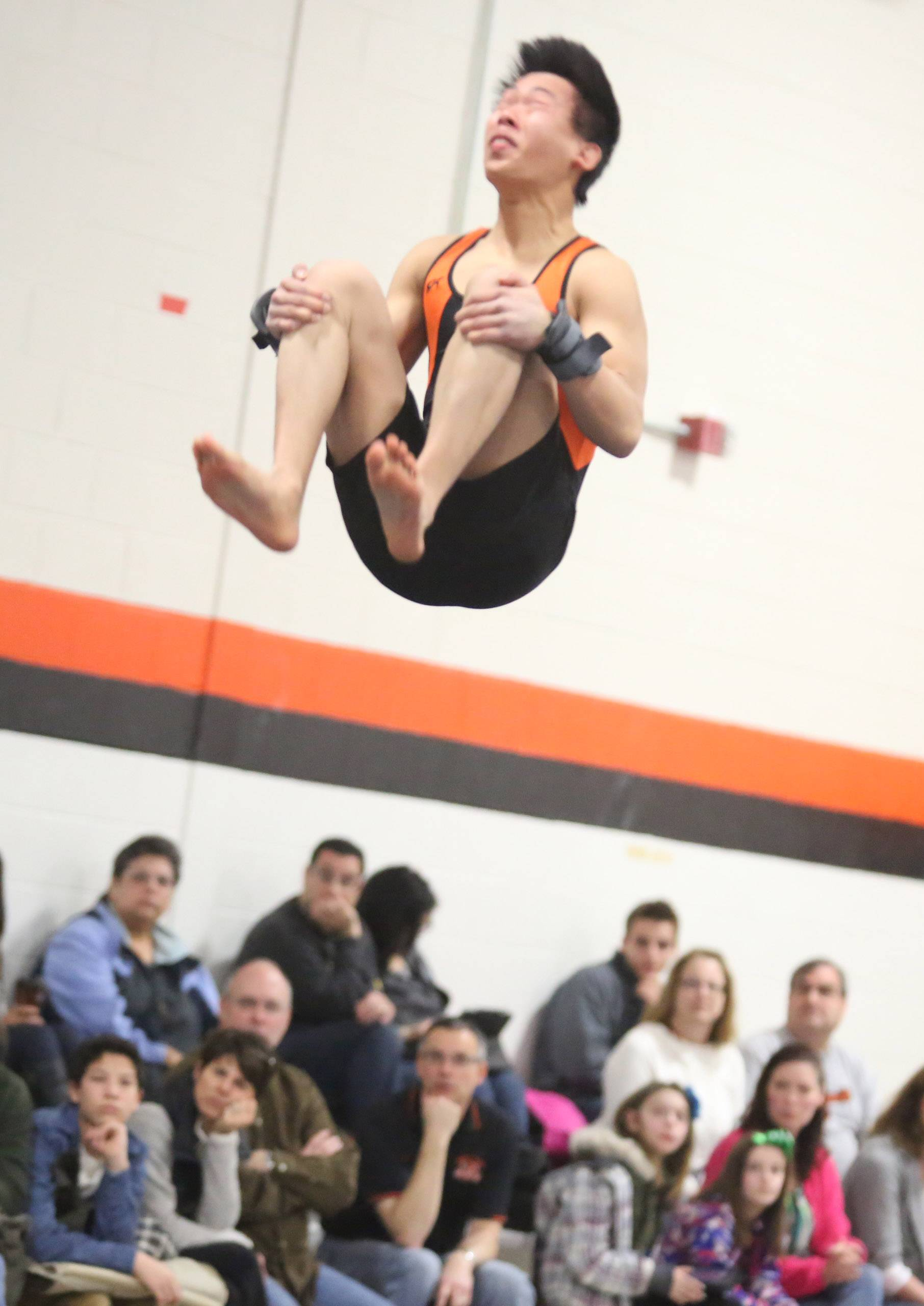 Libertyville's Alex Pong competes on floor exercise on Saturday at Libertyville.