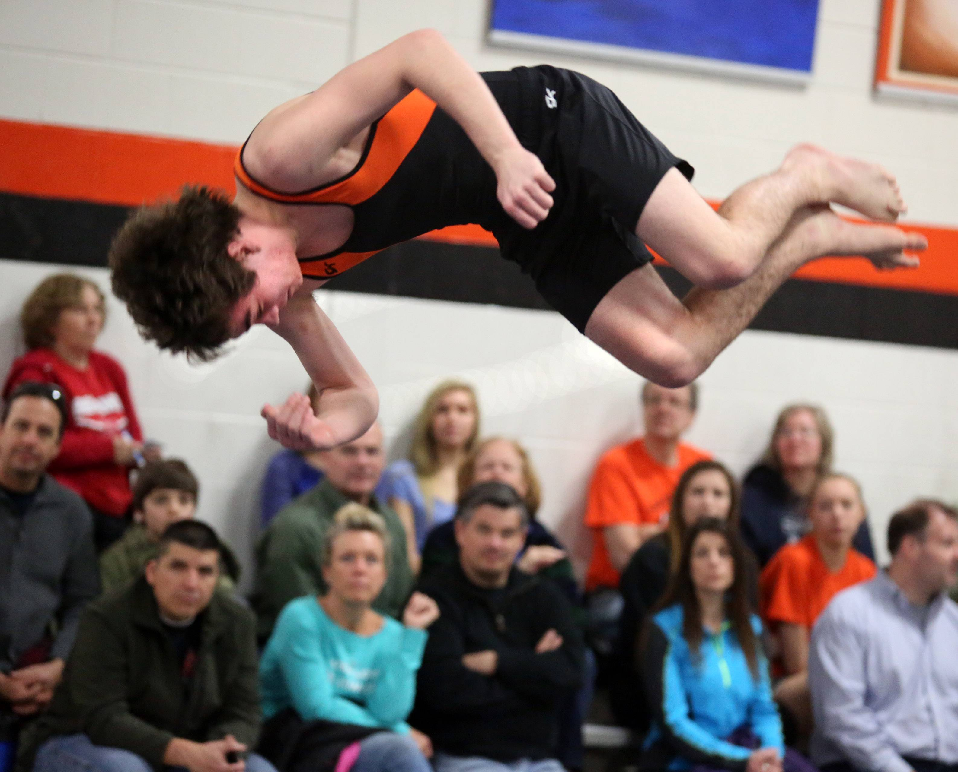 Libertyville's Jade Fisher competes on floor exercise on Saturday at Libertyville.