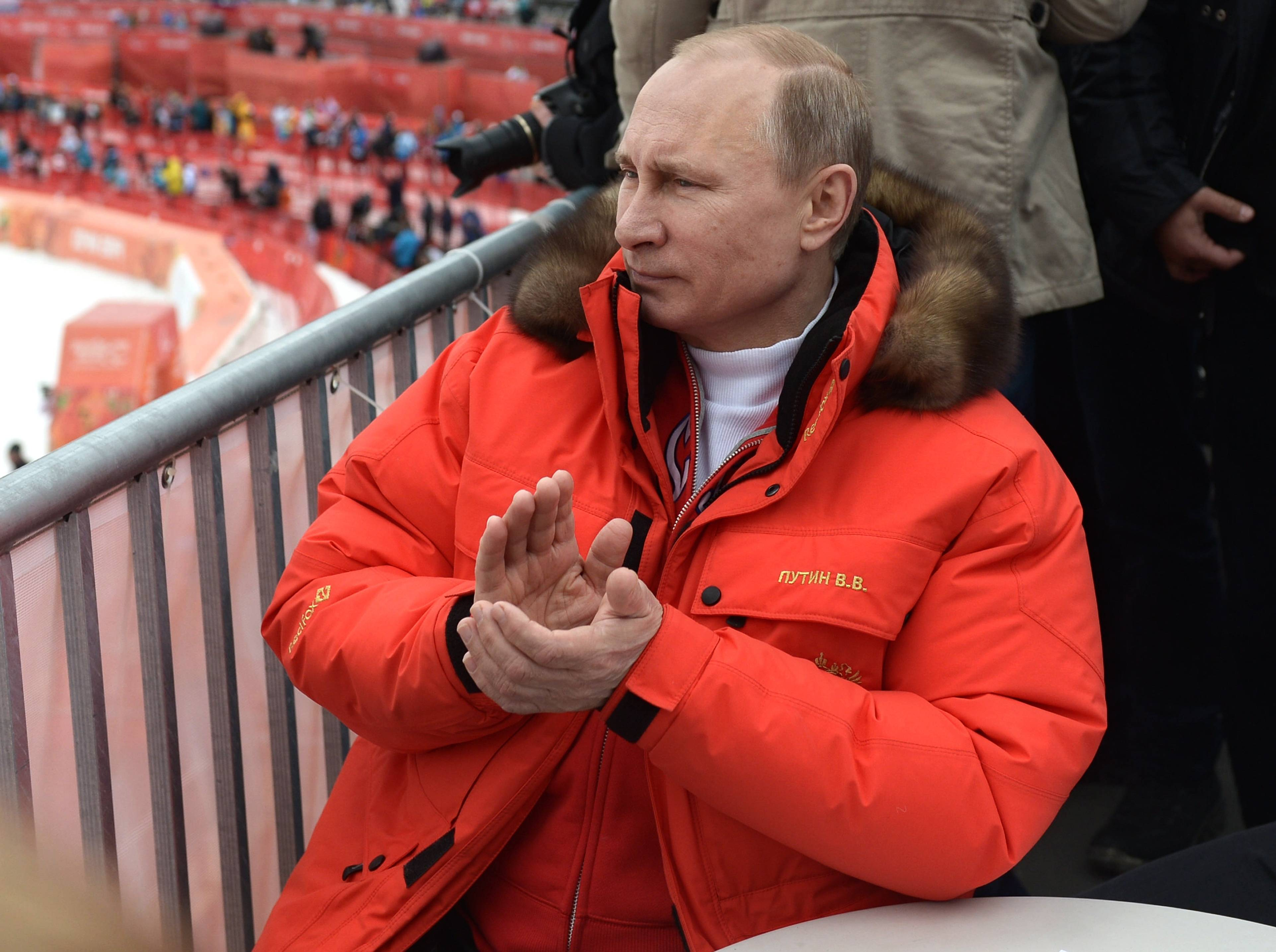 The 2014 Winter Paralympics ended Sunday in Sochi, Russia, the same site at which the Winter Olympics were held last month. In that time, the West's view of Russian President Vladimir Putin, seen here, has undergone a change.