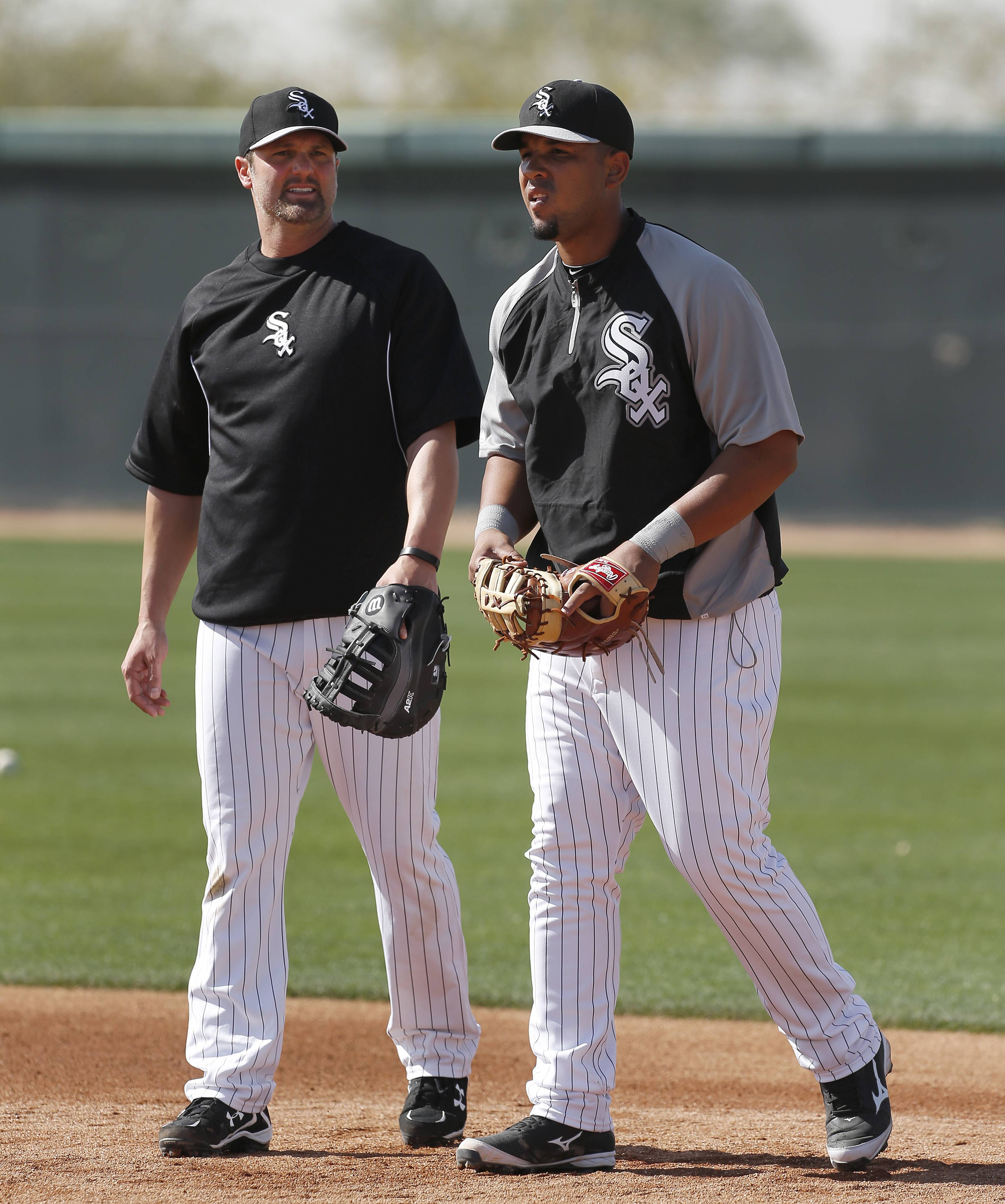 White Sox veteran Paul Konerko, left, is doing all he can this spring to help younger players such as first baseman Jose Abreu.