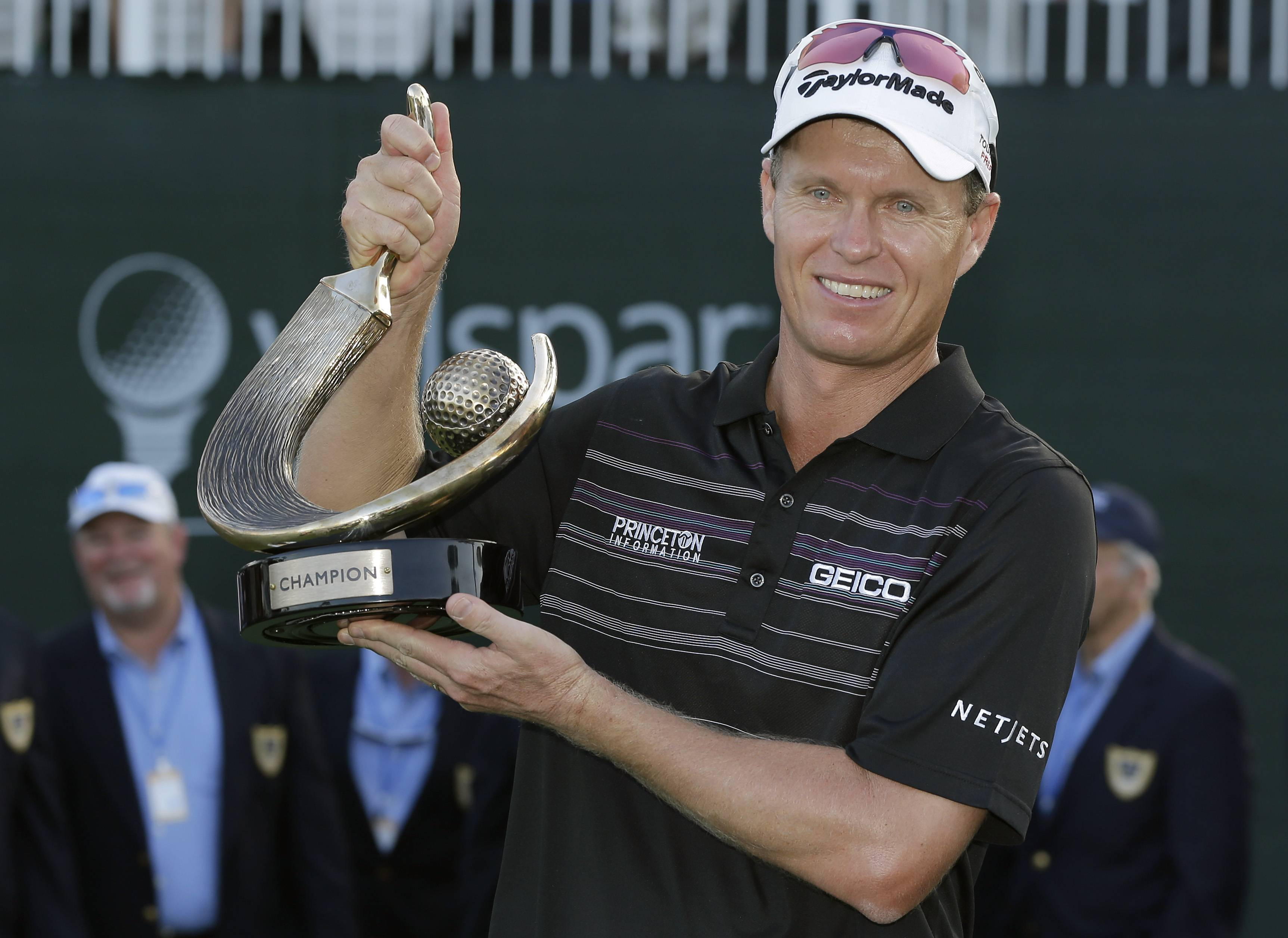 John Senden, of Australia, holds up the trophy after winning the Valspar Championship golf tournament at Innisbrook, Sunday, March 16, 2014, in Palm Harbor, Fla.