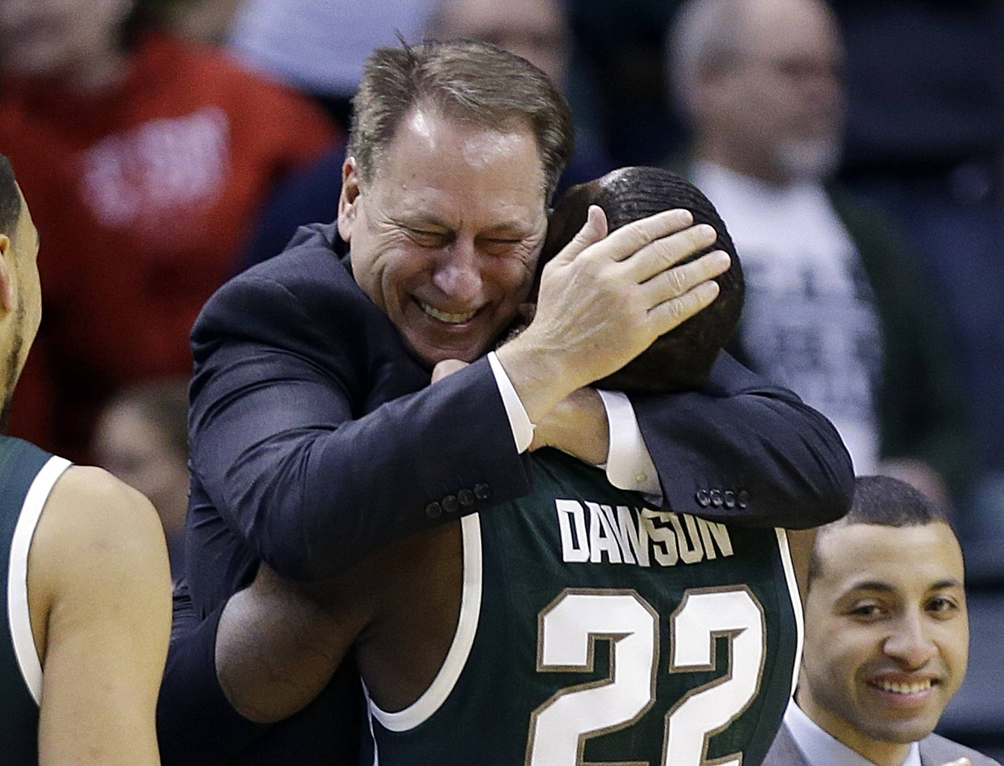 Michigan State guard/forward Branden Dawson (22) hugs head coach Tom Izzo as he walks to the bench in the second half of an NCAA college basketball game against Michigan in the championship of the Big Ten Conference tournament on Sunday, March 16, 2014, in Indianapolis. Michigan State won 69-55.