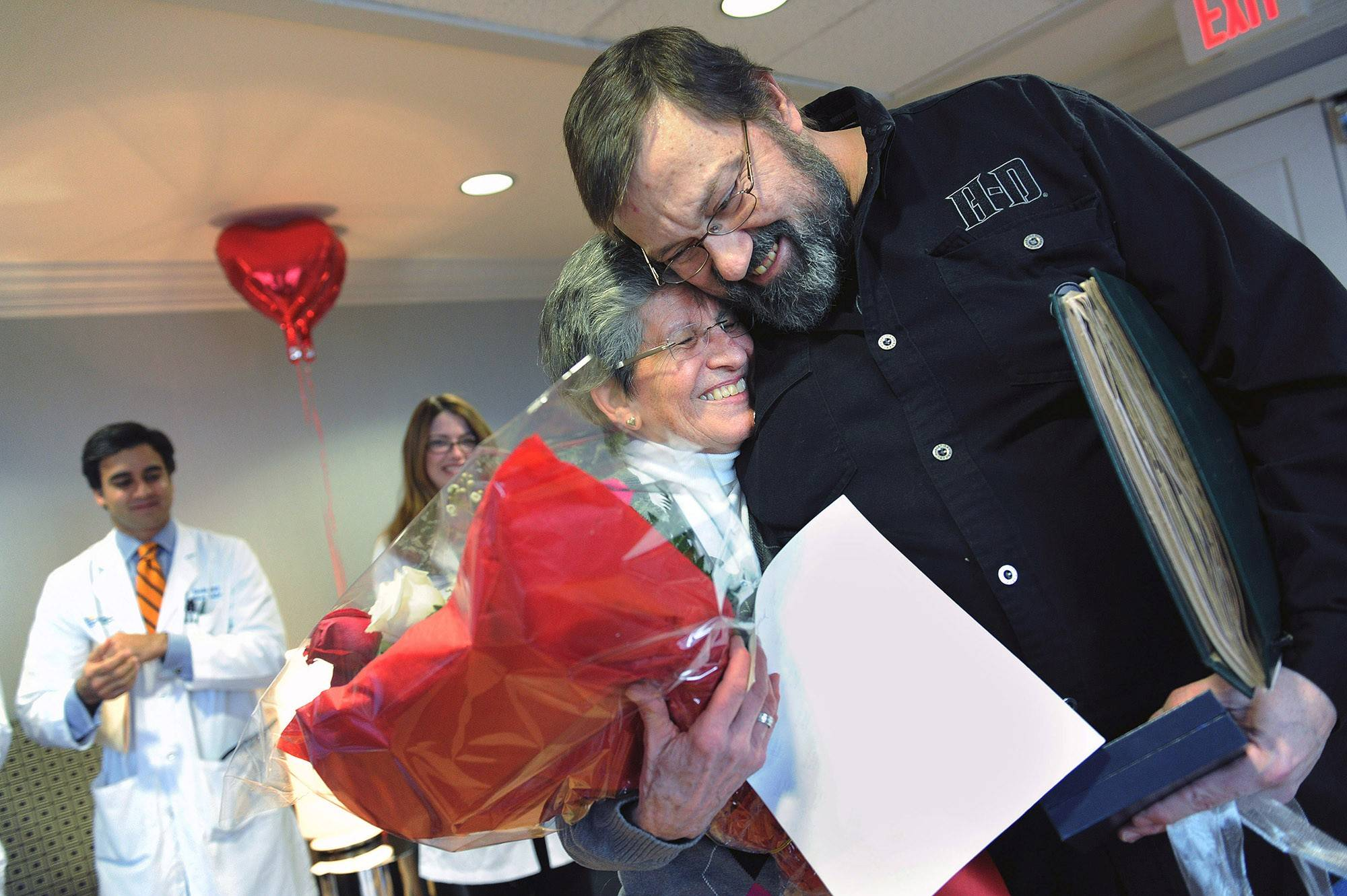 Thomas Cook gets a hug from Susan Knight at MedStar Washington Hospital Center 25 years after receiving a new heart from Knight's son, Jeff Brown.